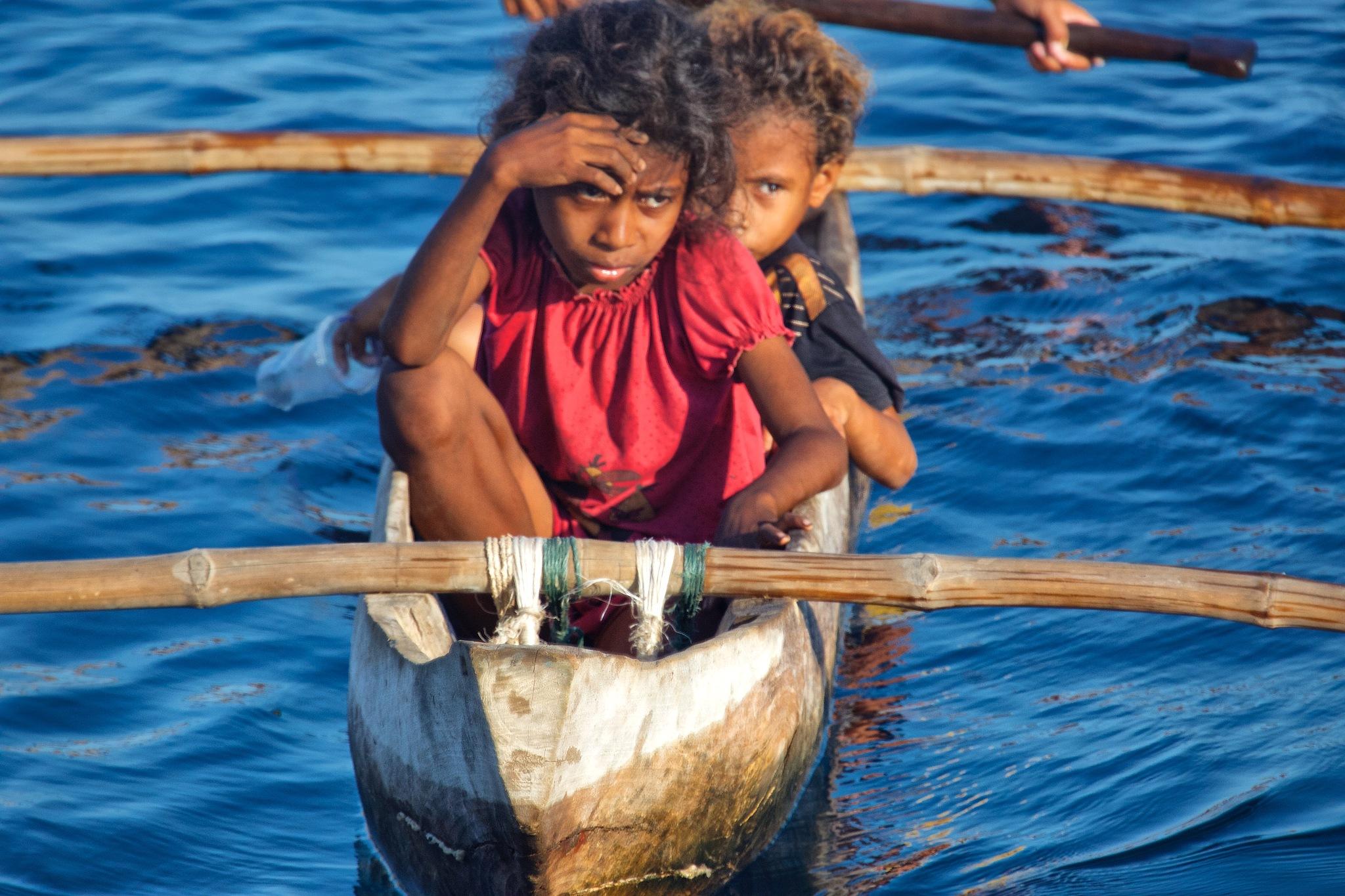 Children living under the volcano (series) by Tom K