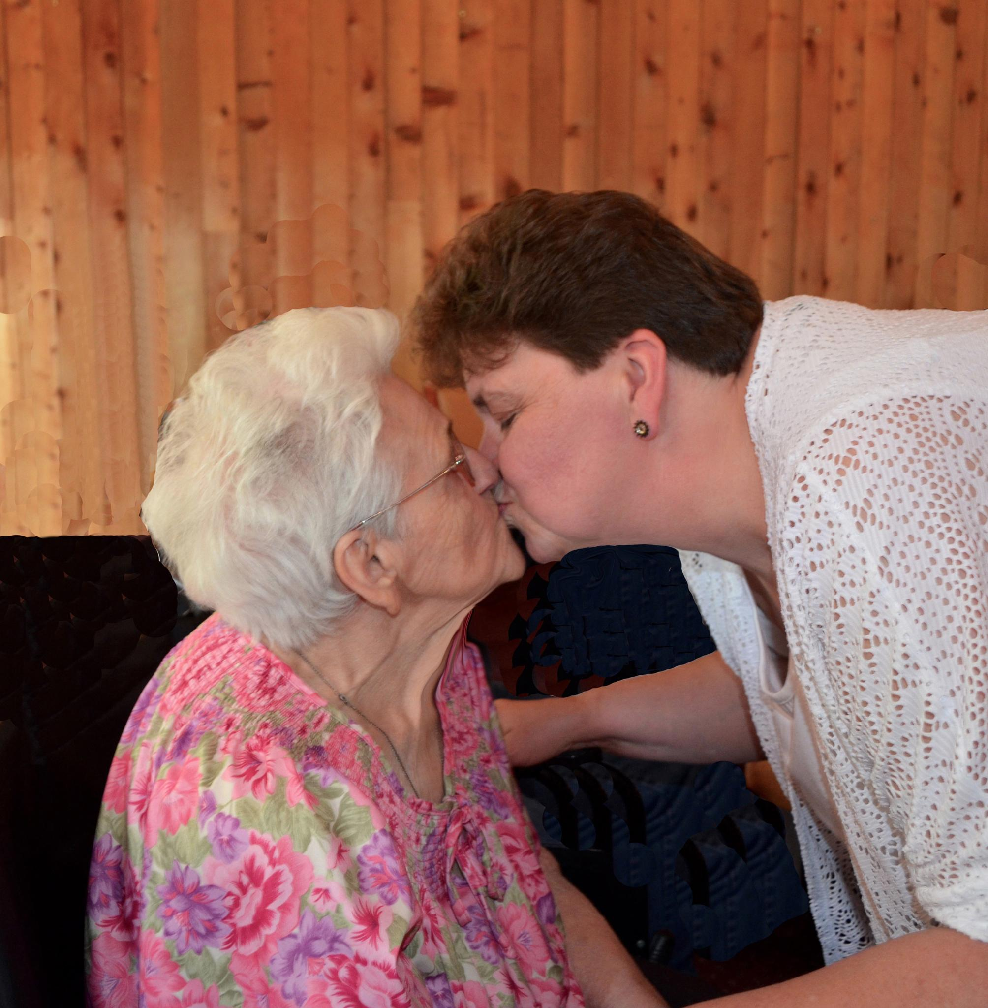 Mom's 90th Birthday kiss by John Mckay
