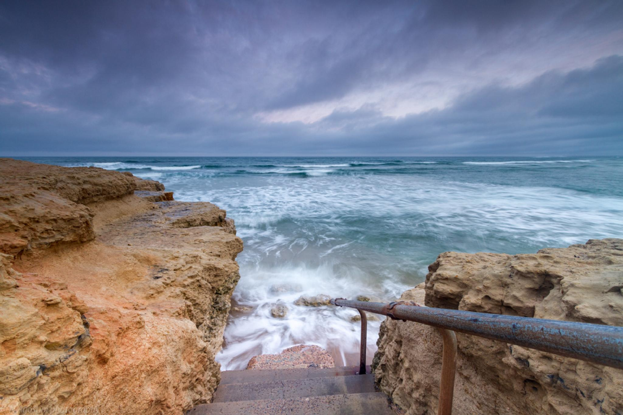 Steps in water by Nathan Agostini