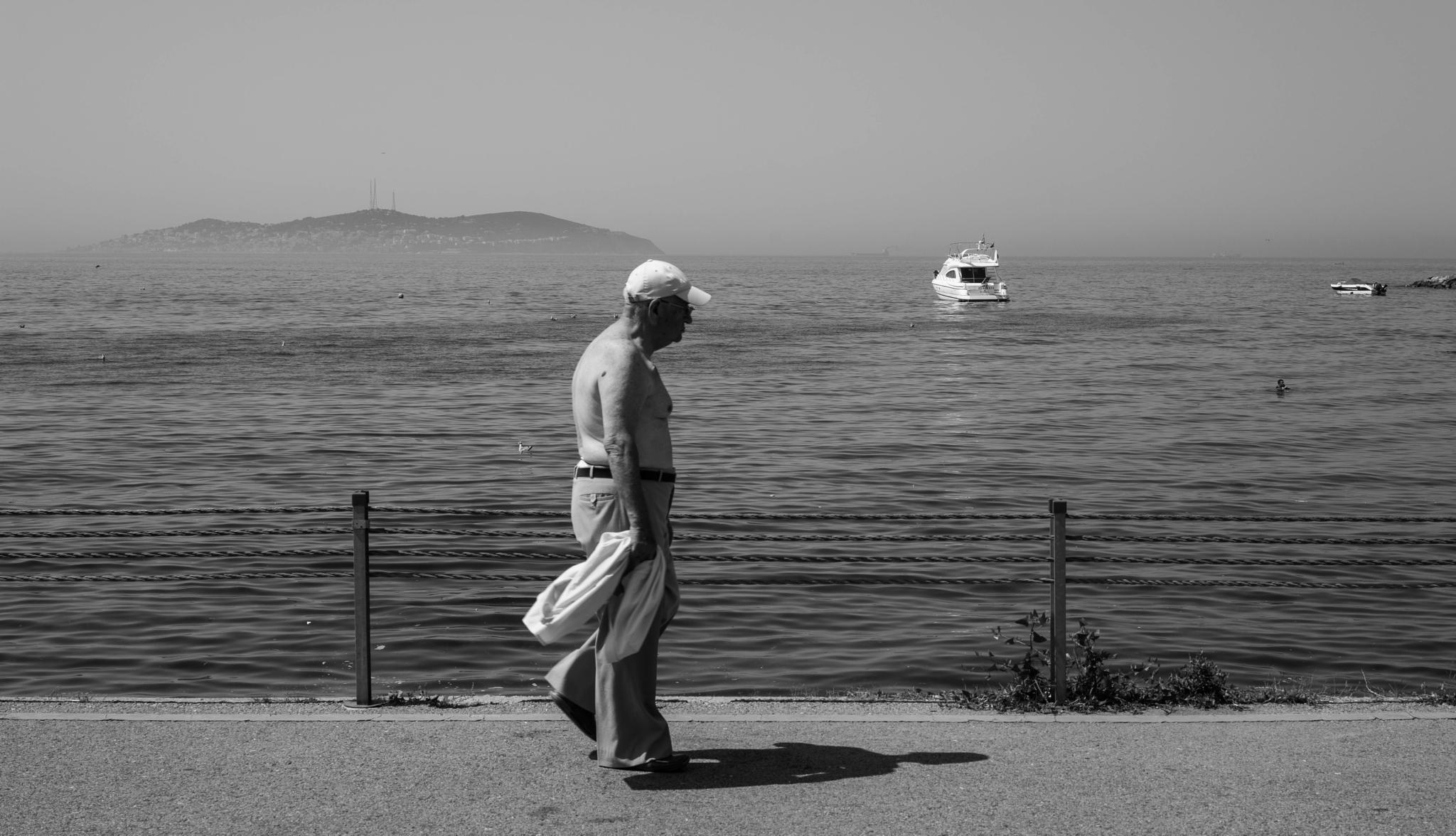 Old man on beach by hbilgen