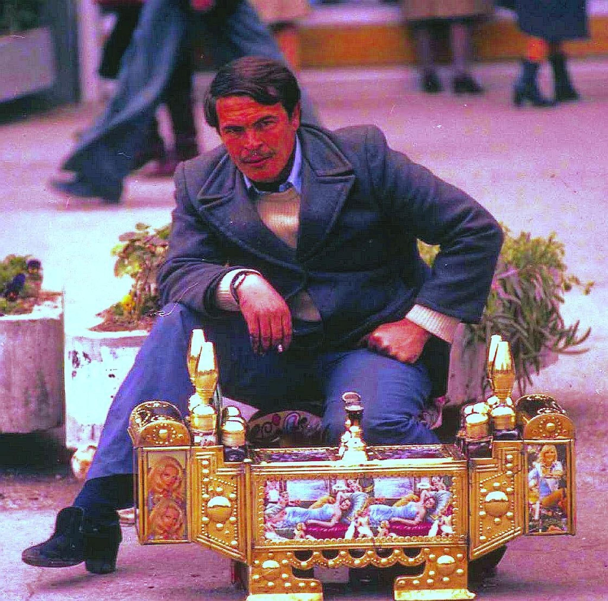 Turkish shoe shine man by Mike Thompson