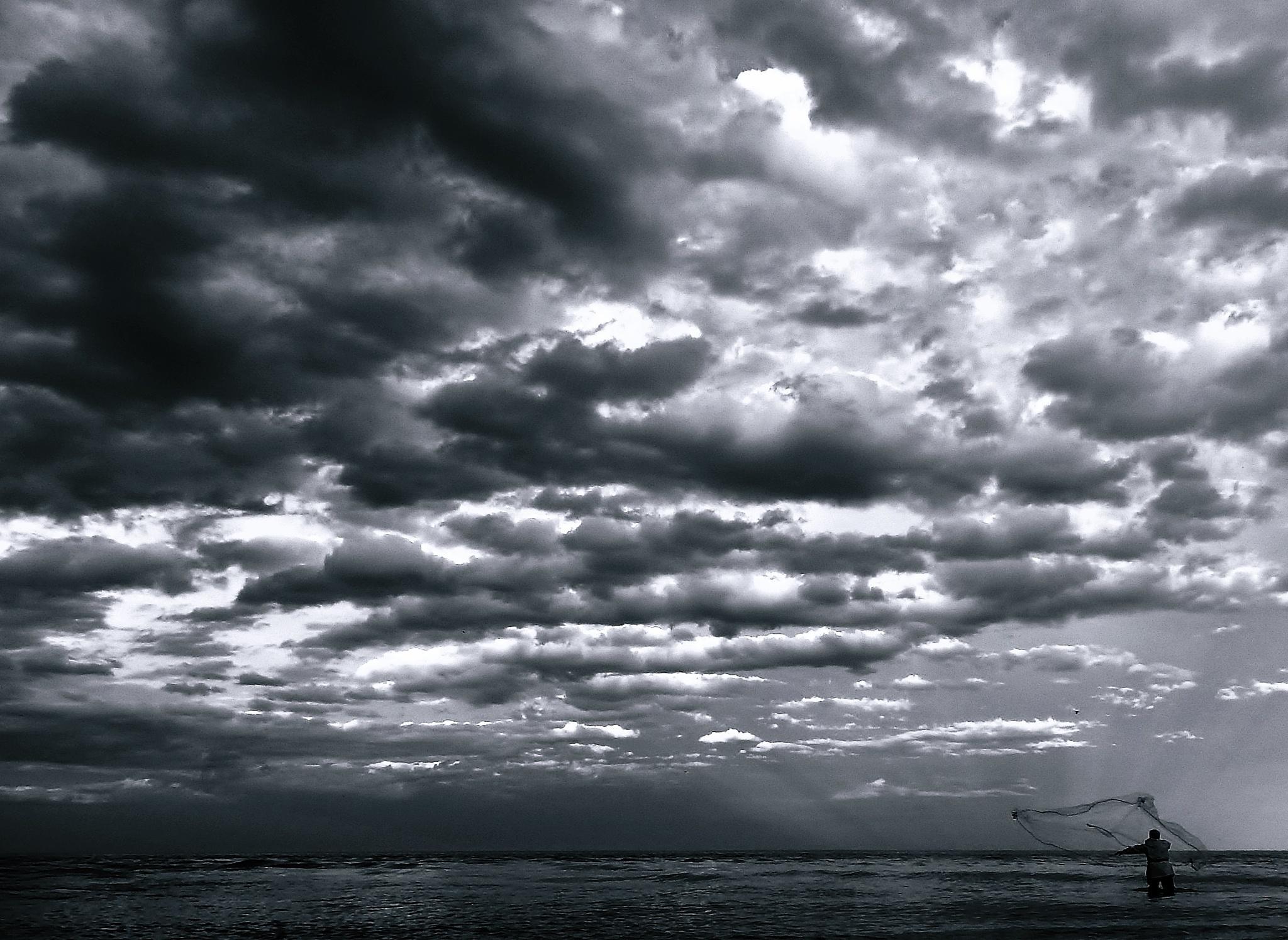 fisherman clouds by Nelu Tana
