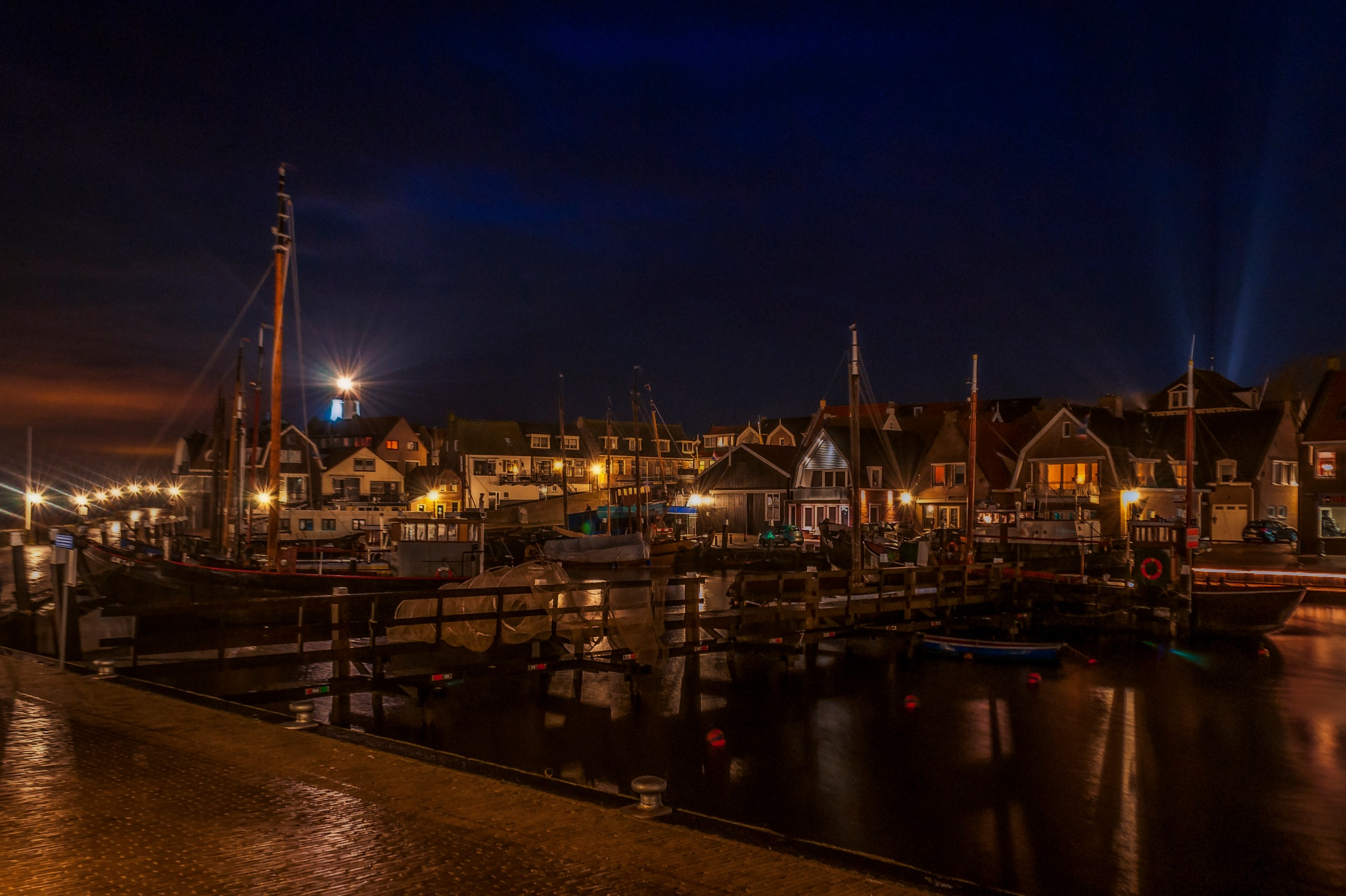 Urk, old school fishingharbour in Holland waking up. by Robin Pulles