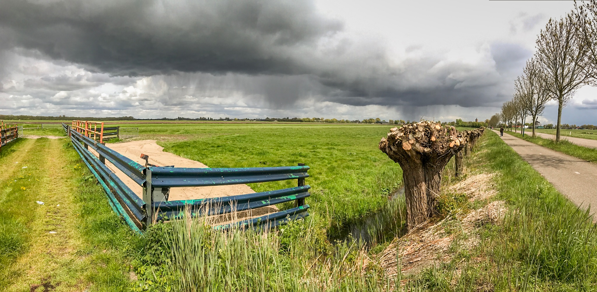 Rain over the fields of Holland by Robin Pulles