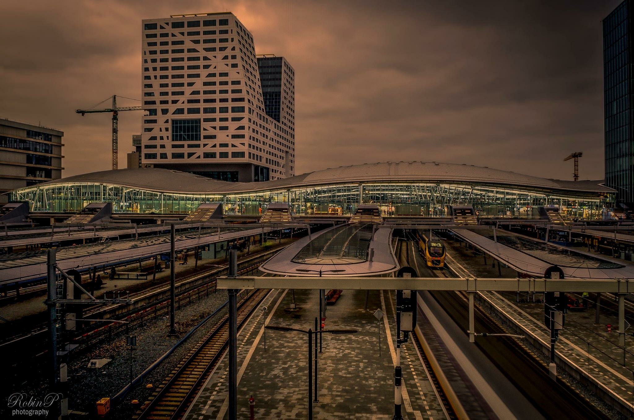 Dutch skies over a Dutch trainstation by Robin Pulles