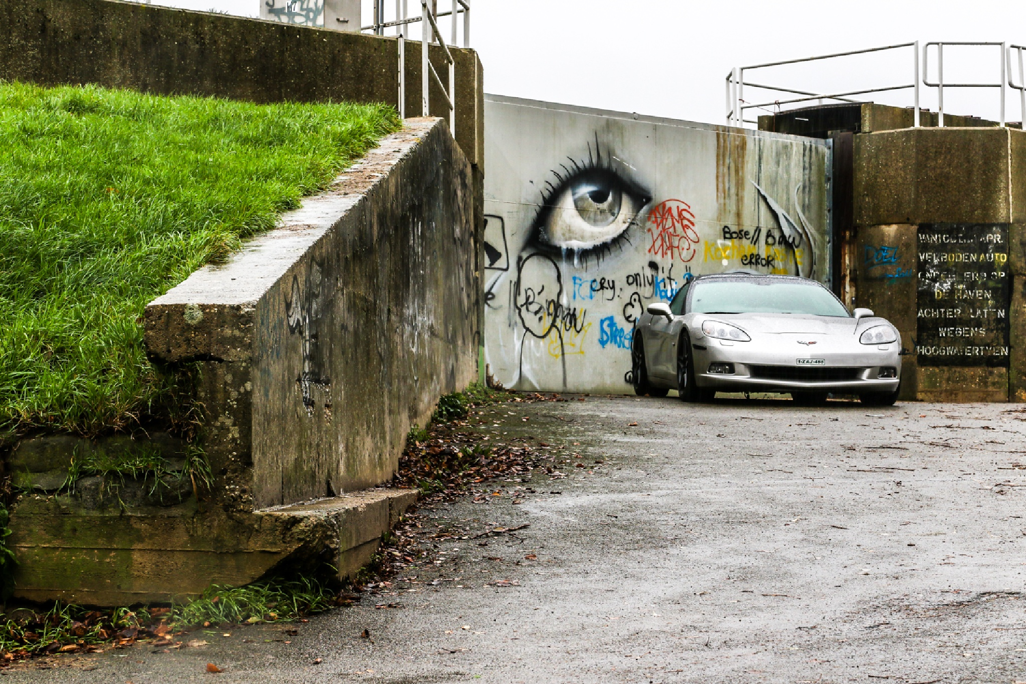 expensive car in a deserted village by Ronny Andries