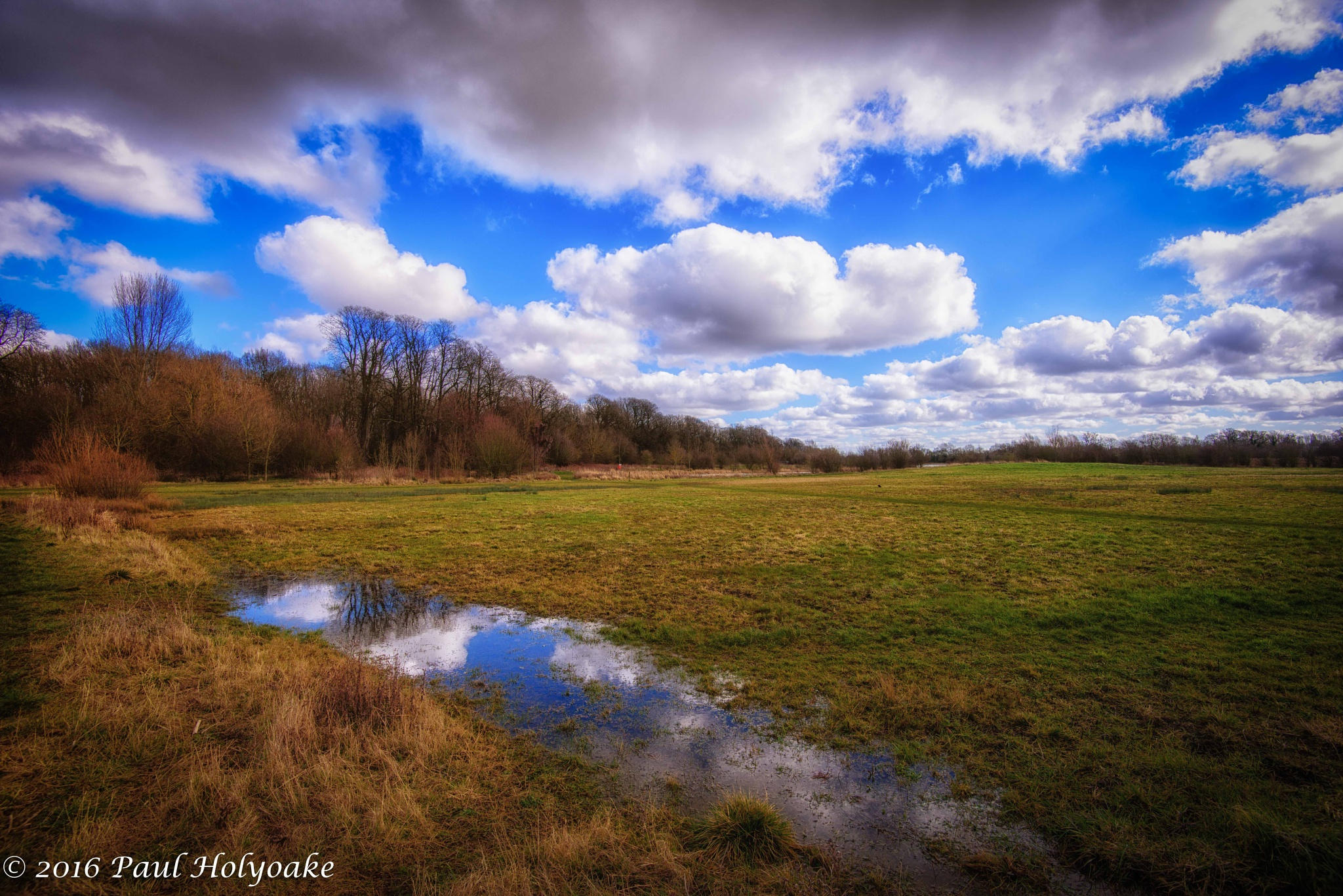 Clouds in the puddle by Photon