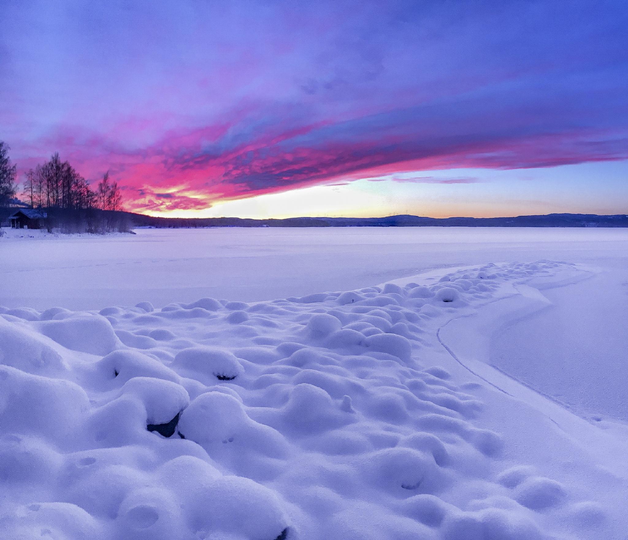 Snowey sunset by Marcus Holmqvist