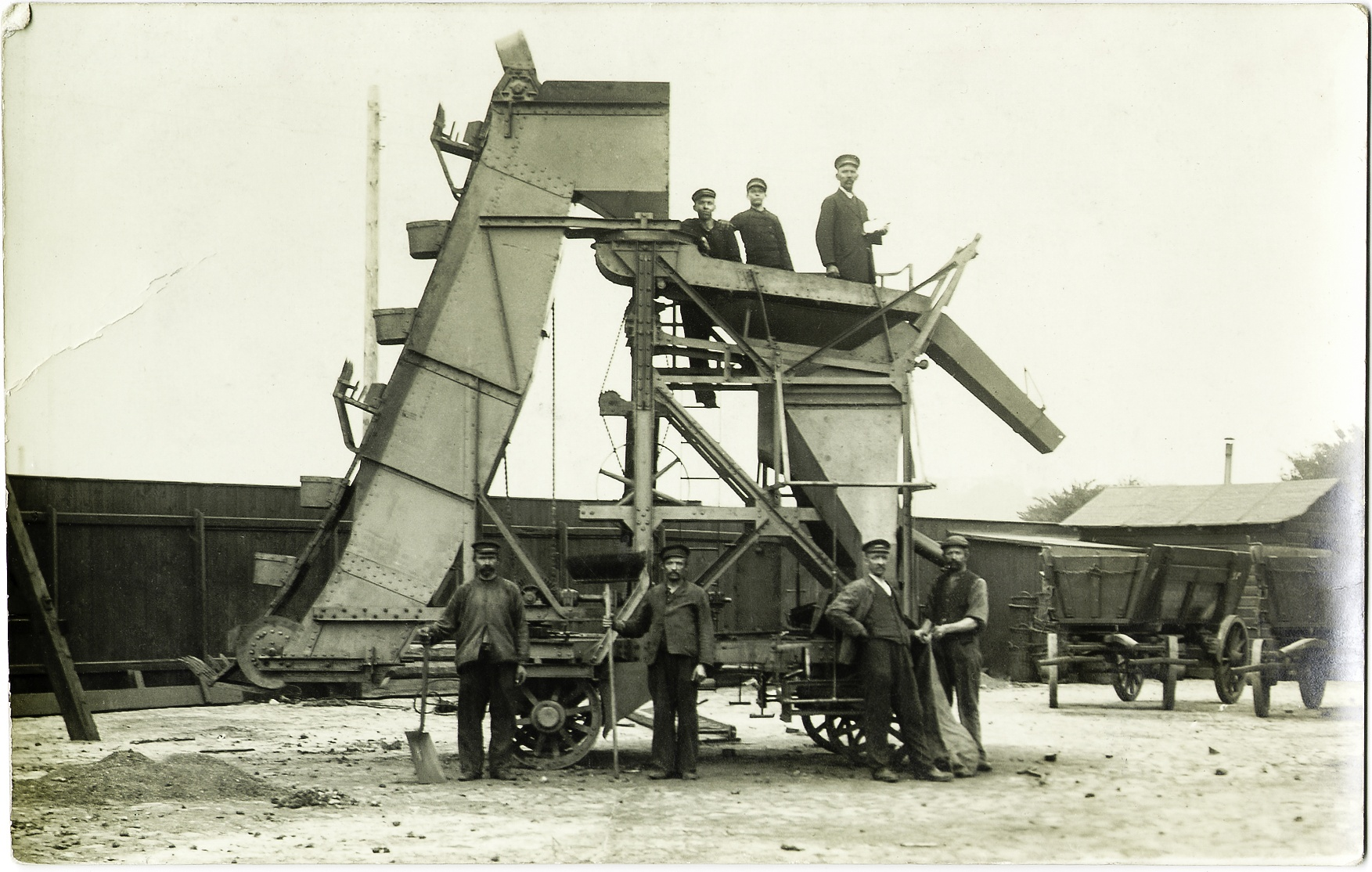 Vintage crusher in a mine, with workers, ca. 1910 by Martine de Lajudie