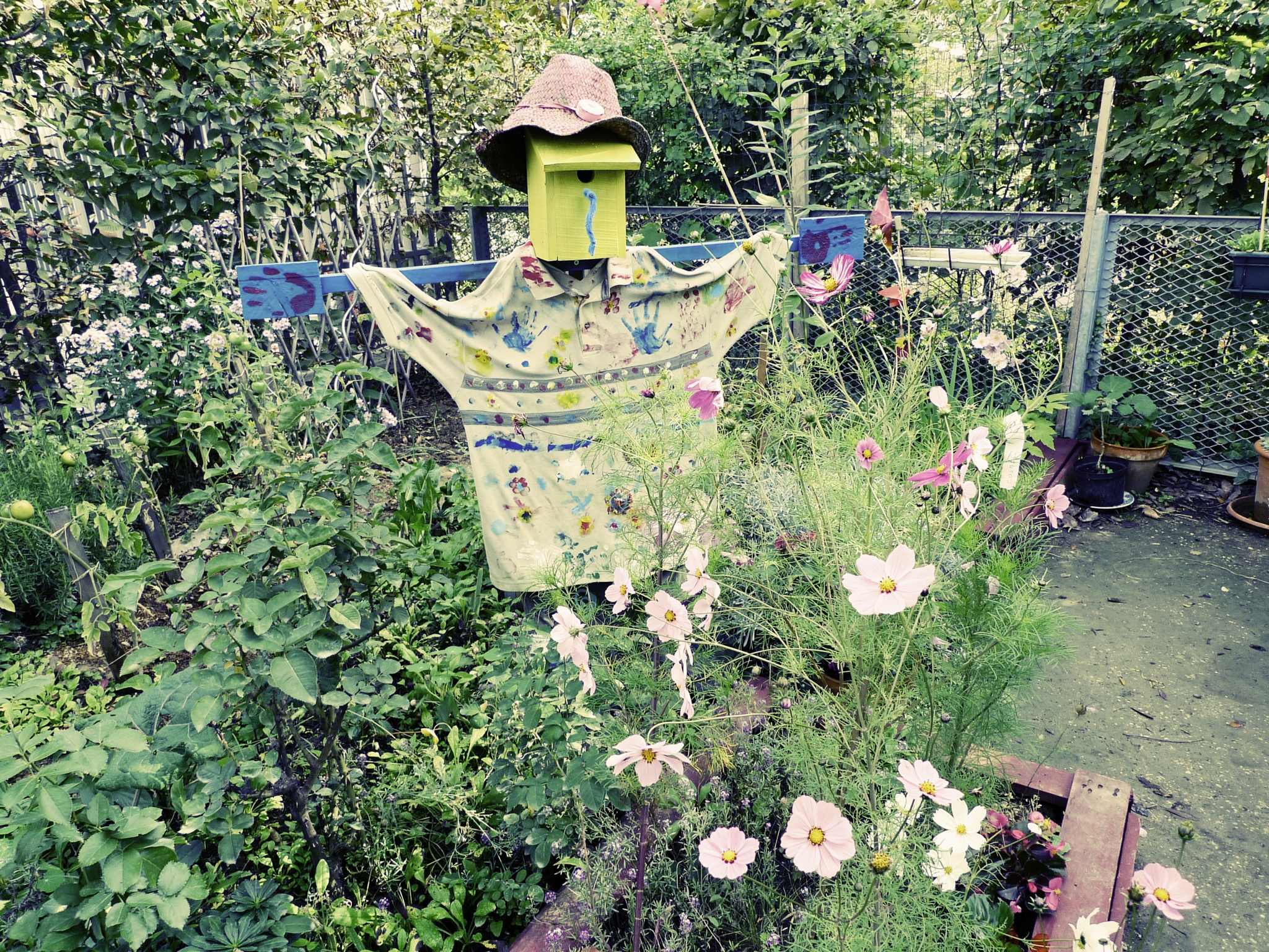 Community garden with scarecrow, Martin-Luther-King park, Paris by Martine de Lajudie