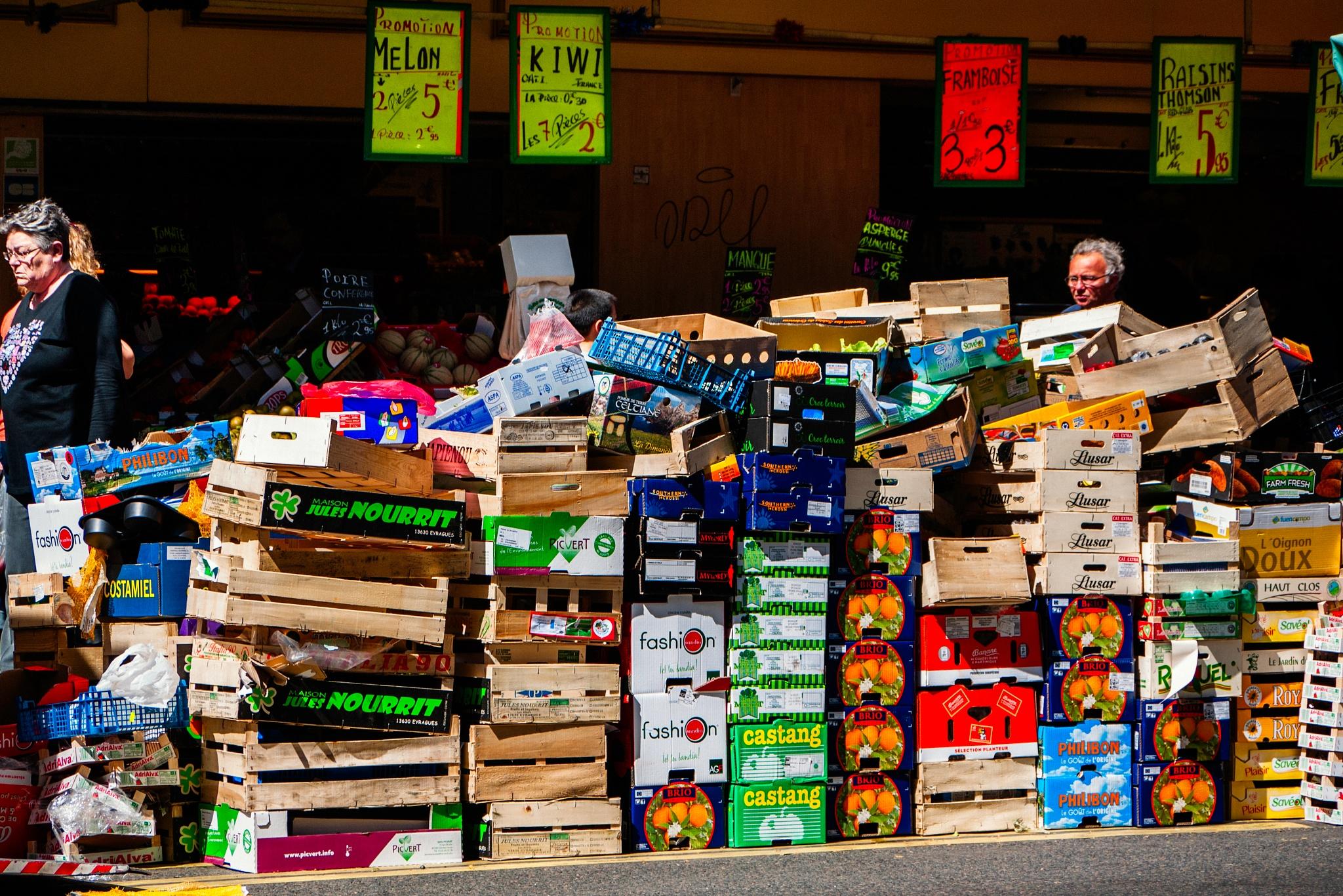 Crates at the end of market, avenue de Saint-Ouen, Paris by Martine de Lajudie