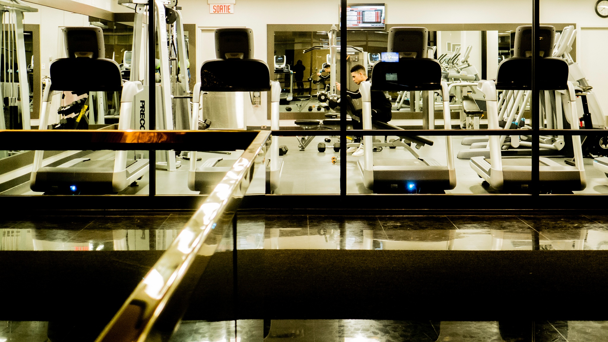 Fitness room with one exercising, EVO, Montreal by Martine de Lajudie