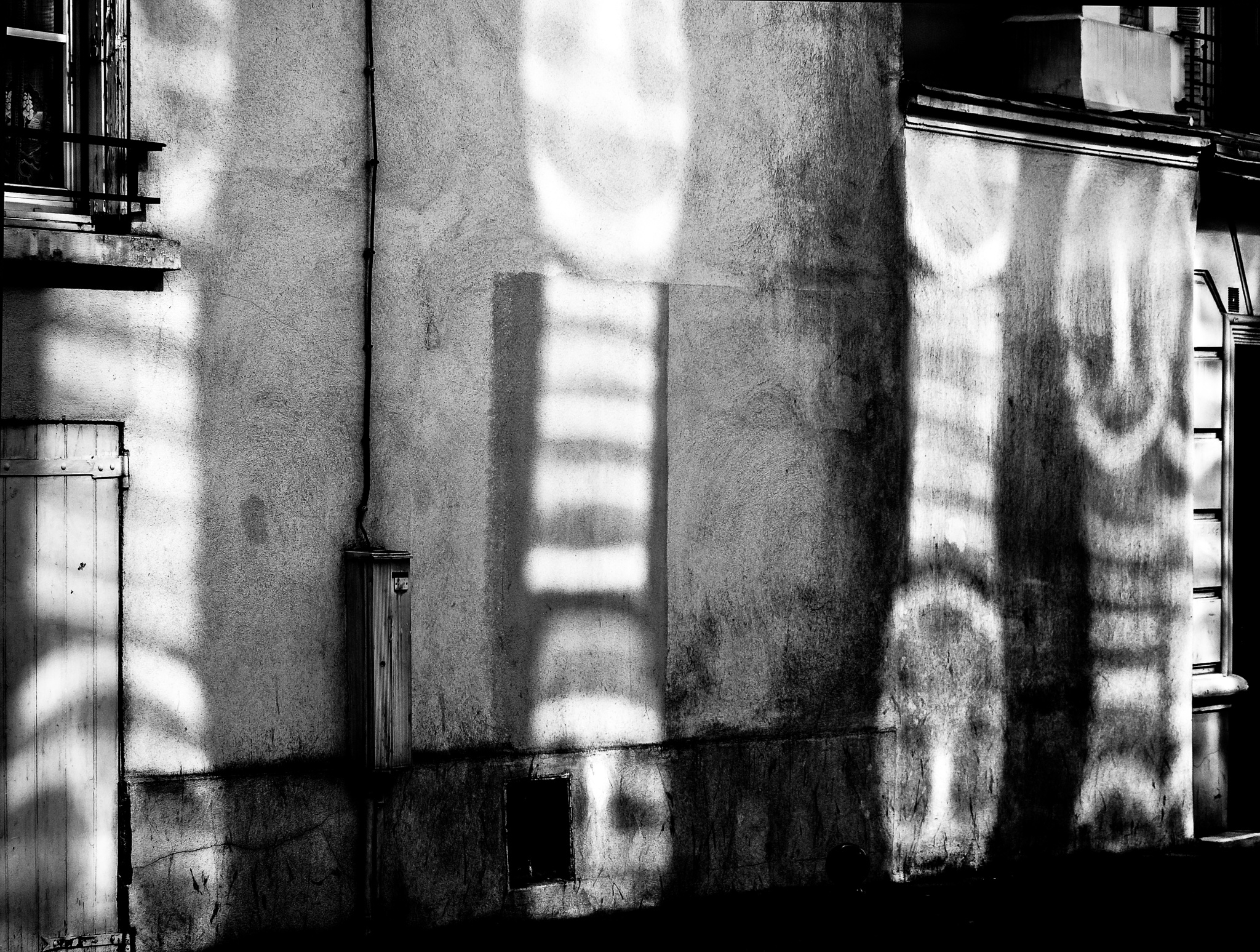 Abstract shadows on a wall, Paris by Martine de Lajudie