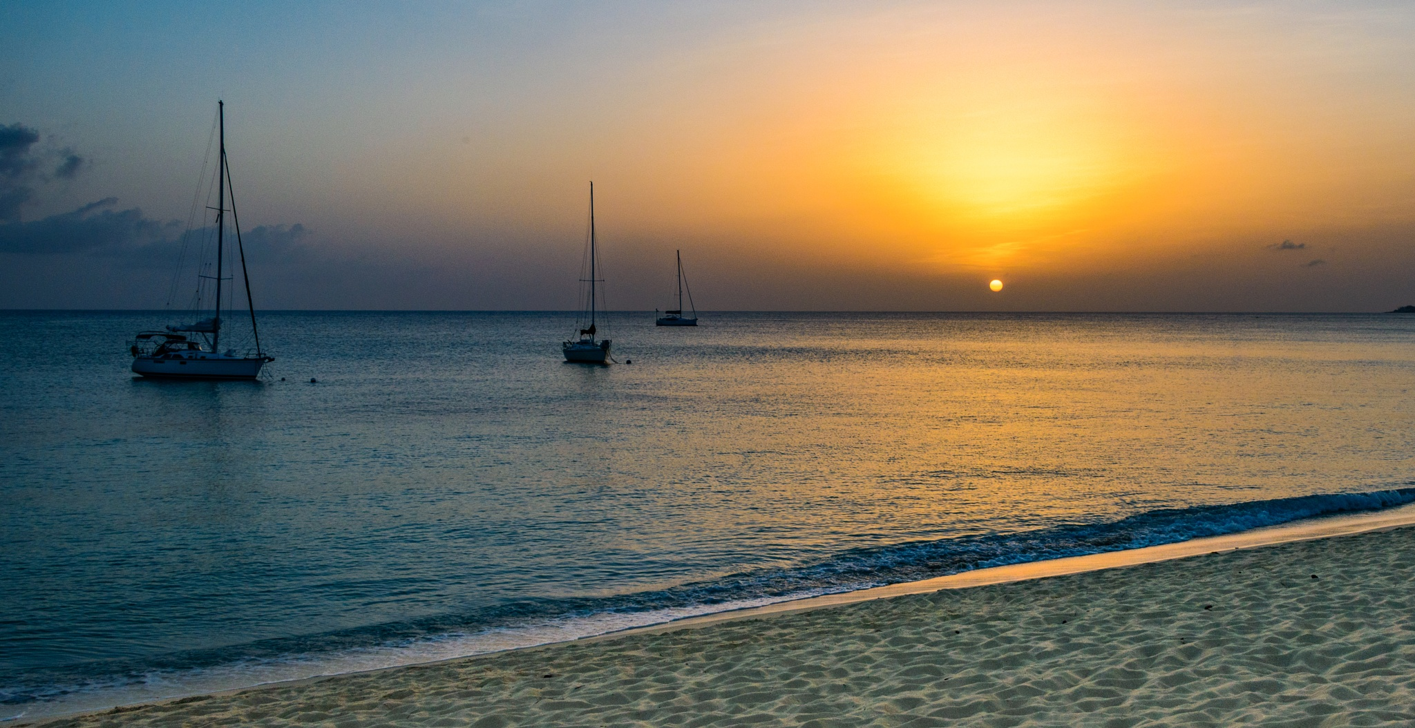 Sunset at Seven Mile Beach by Steve Director