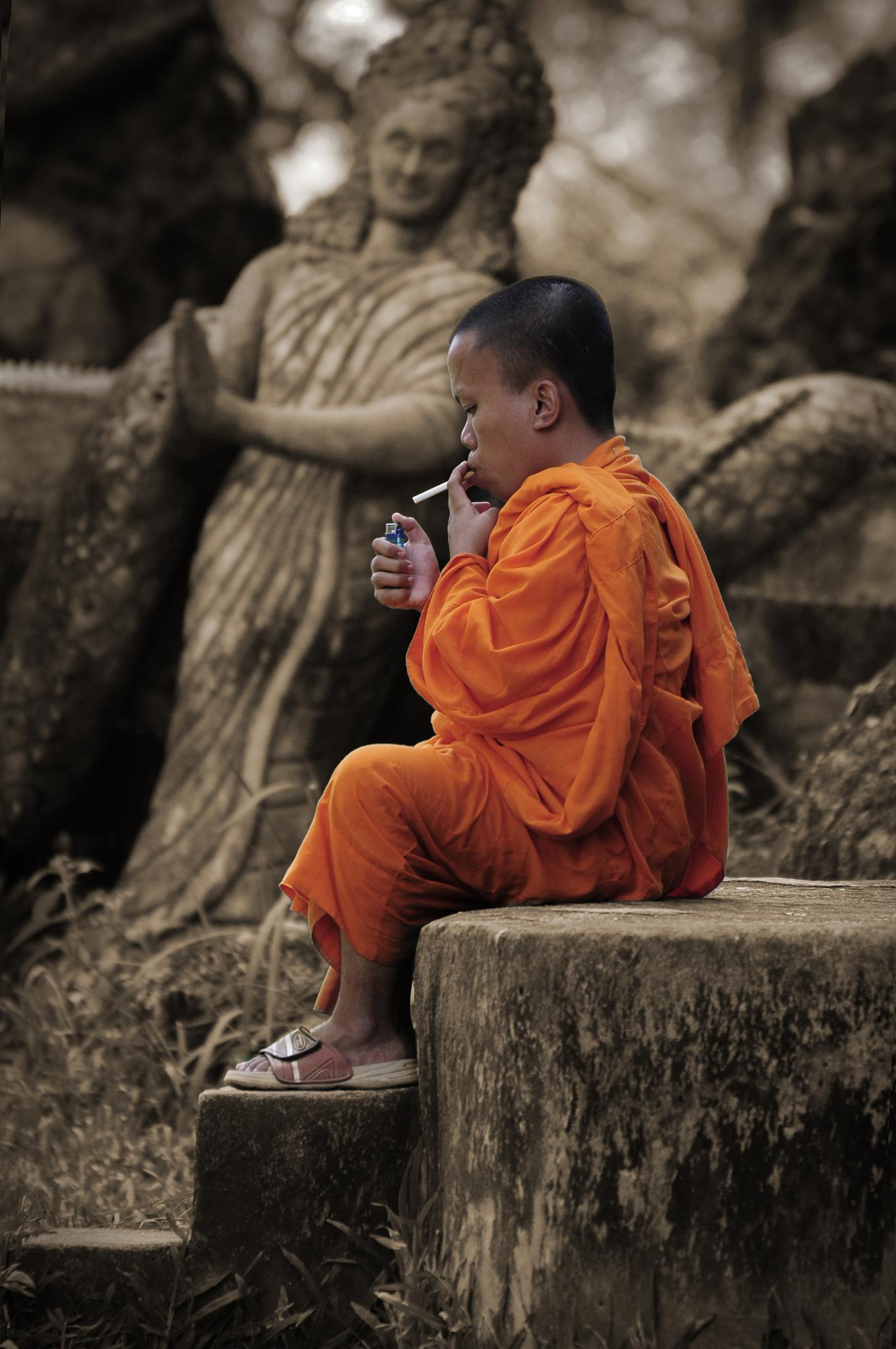 smoking monk by Tommy Seiter