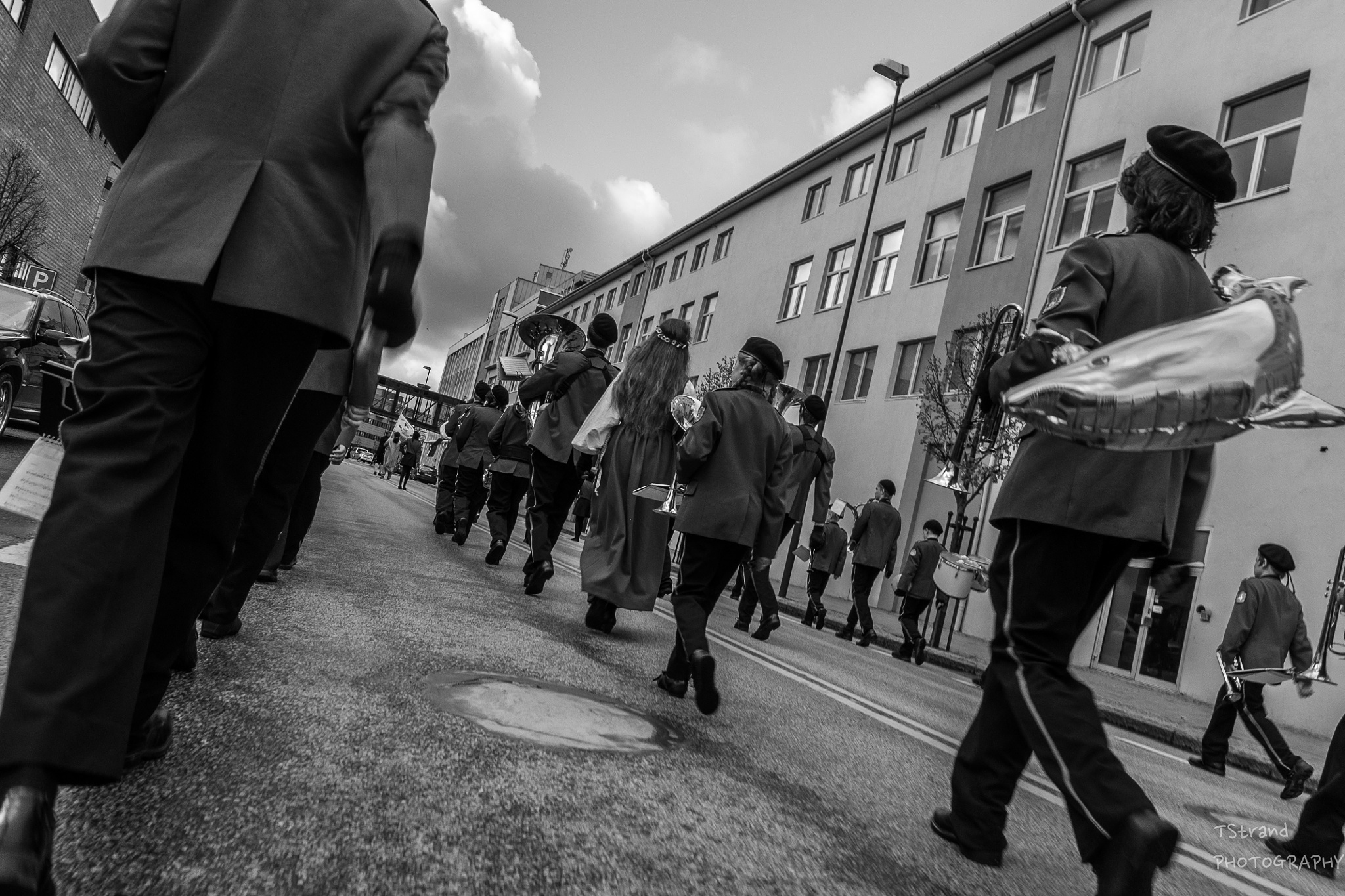 The tail of a marching band by Trond Strand