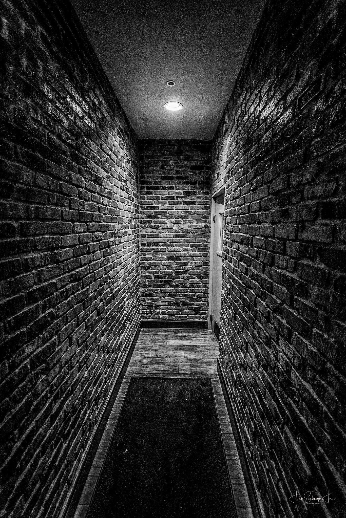 What's at the end of the Hall? by John Schneyer
