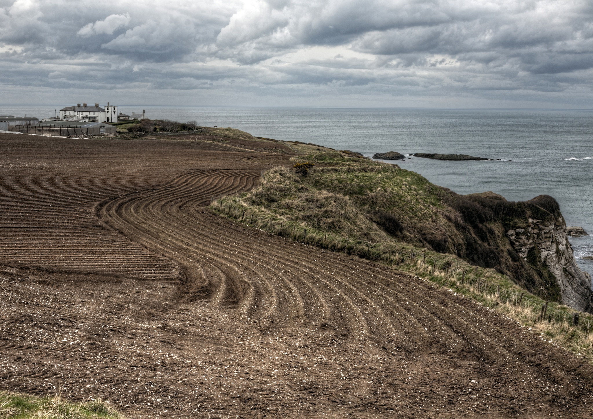 Ploughed field on the Antrim coast. by Peter Ellison