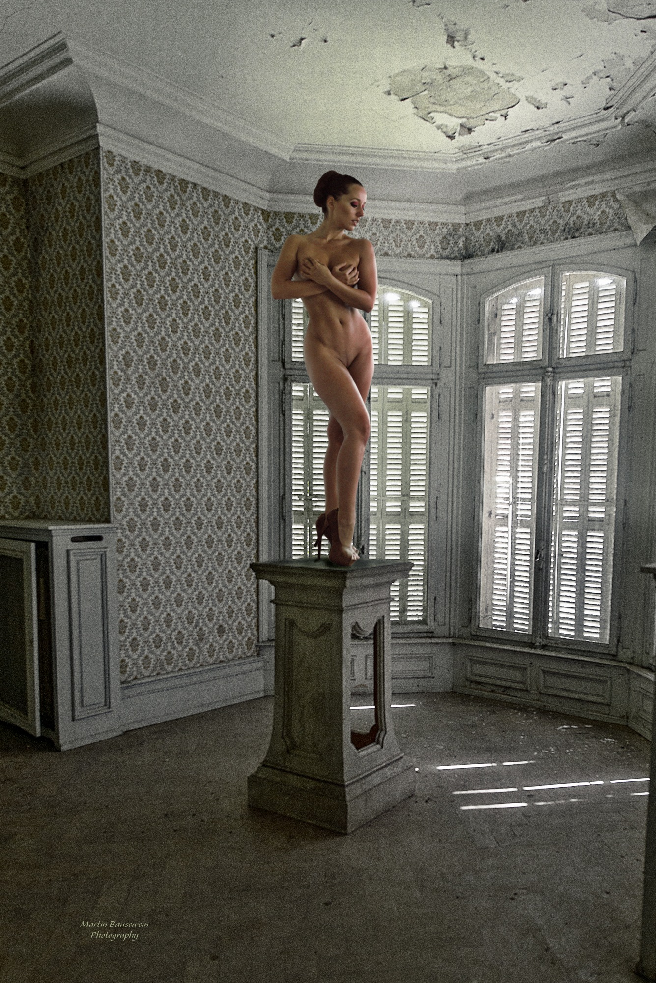 statue in a forgotten mansion by Martin Bausewein
