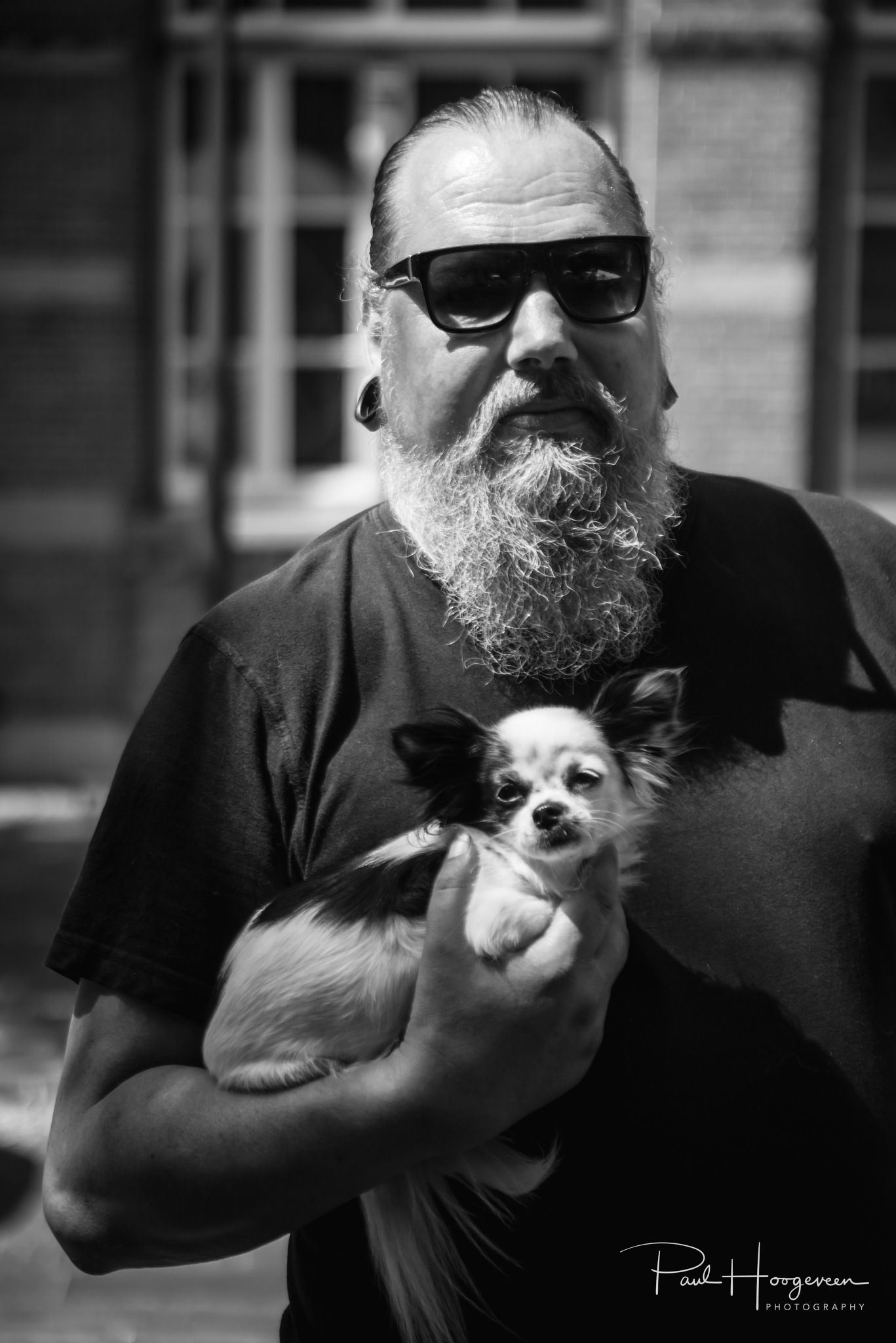 Man with dog by Paul Hoogeveen Photography