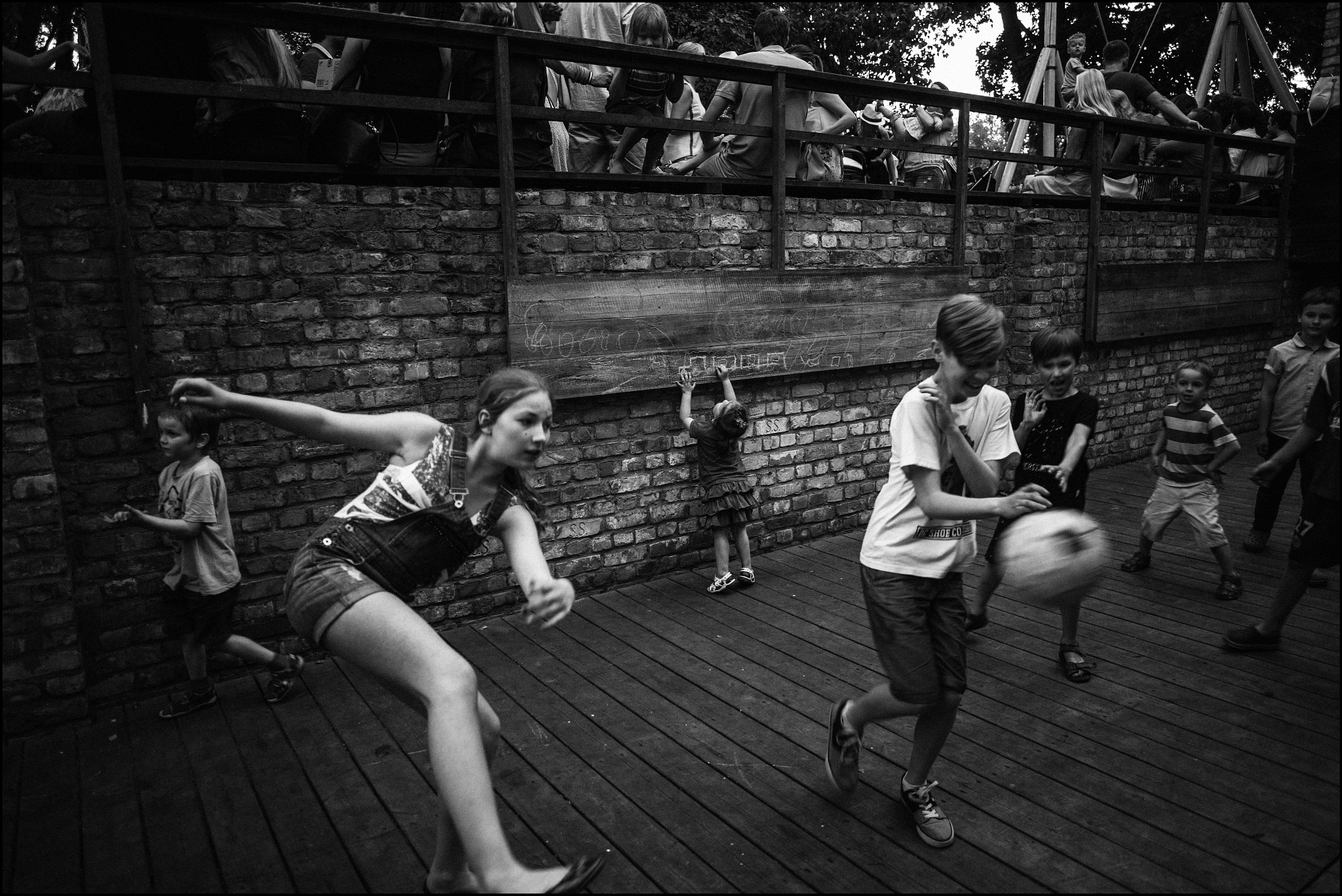 Photo in Street Photography #black #white #black & white #football #playing #sport #fear #urban #city #kids #action #drawing #ball