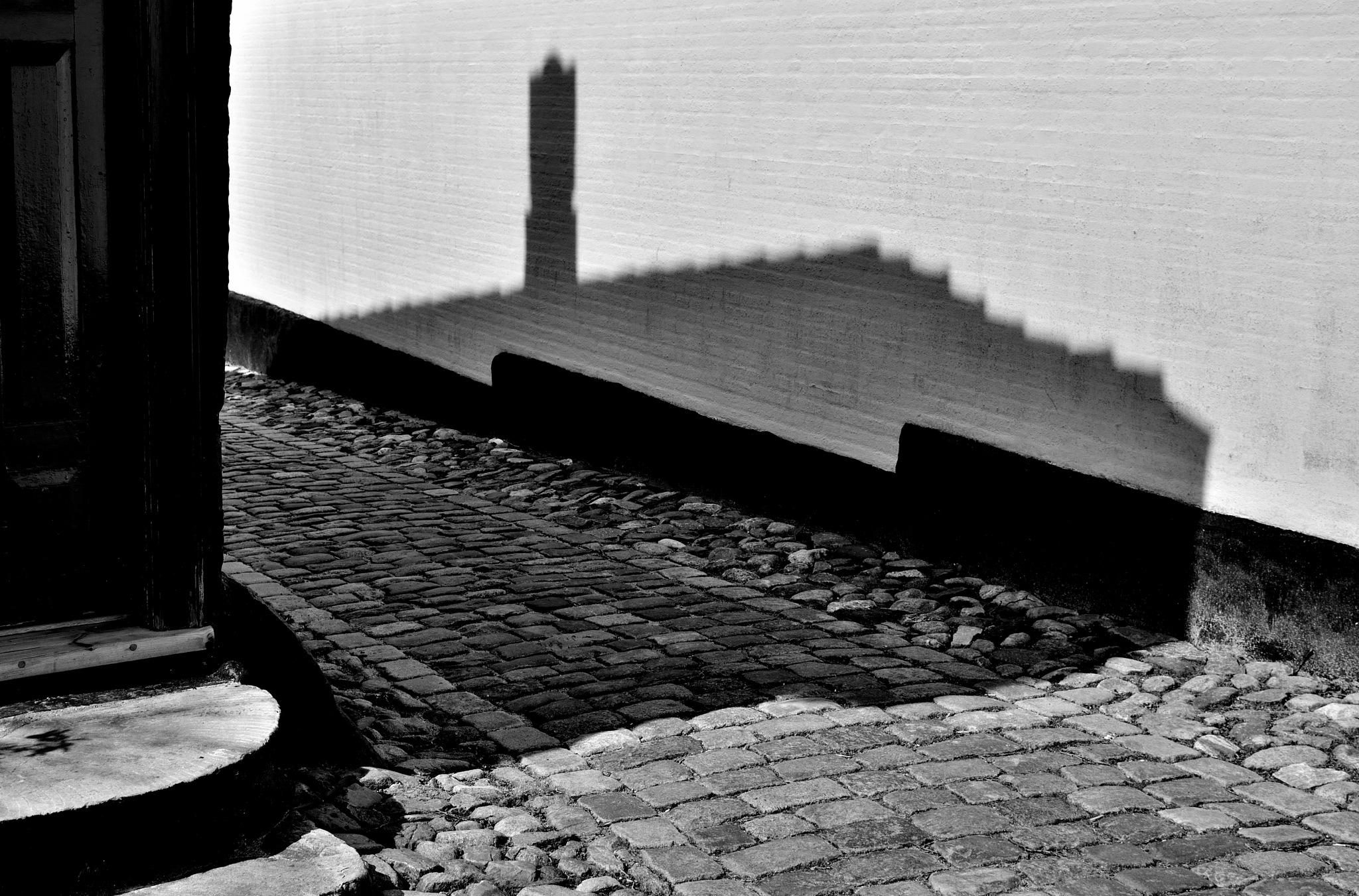 cobblestones and shadows by Poul-Erik Riis