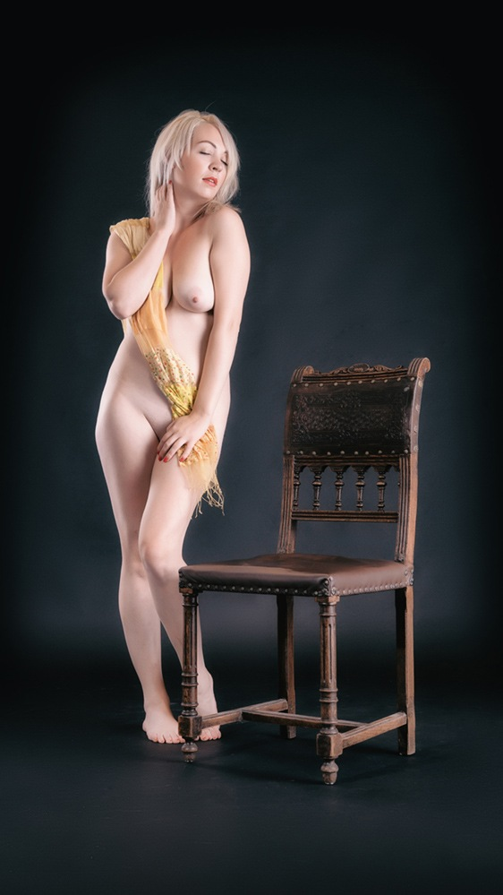 with antique chair by John Herm