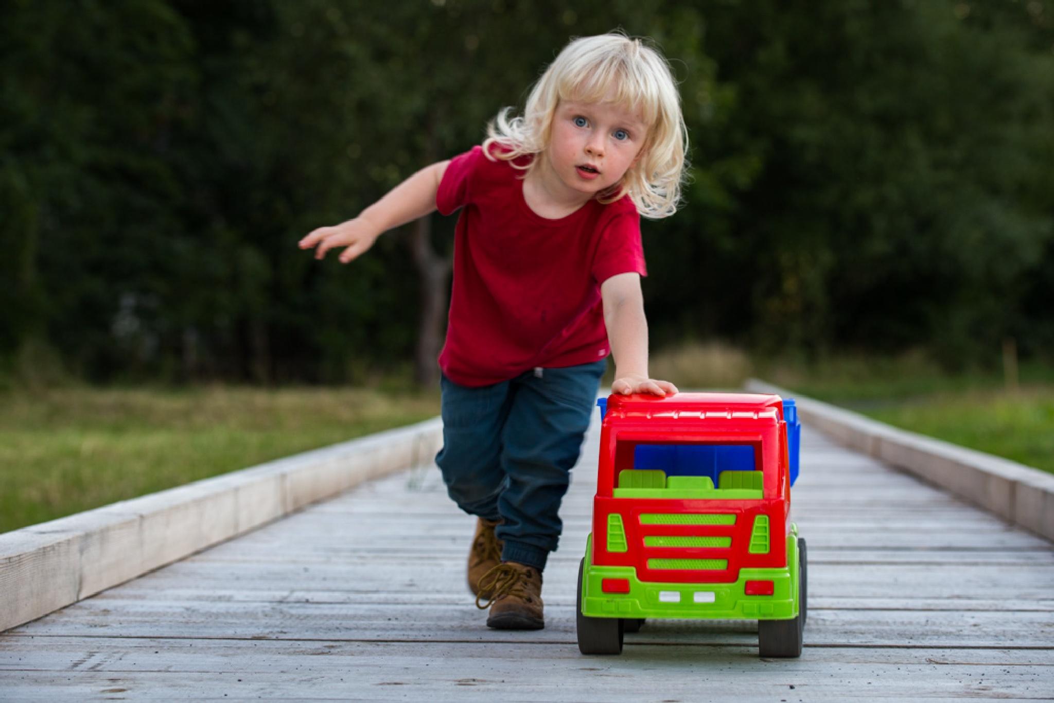 a boy and his truck by Sergej Juganov