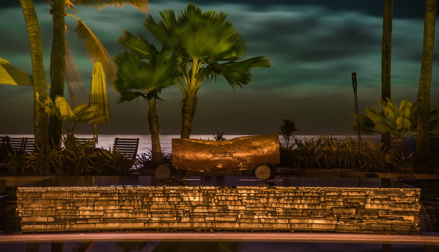Fijian drum backlit by the full moon by Trevor McKinnon