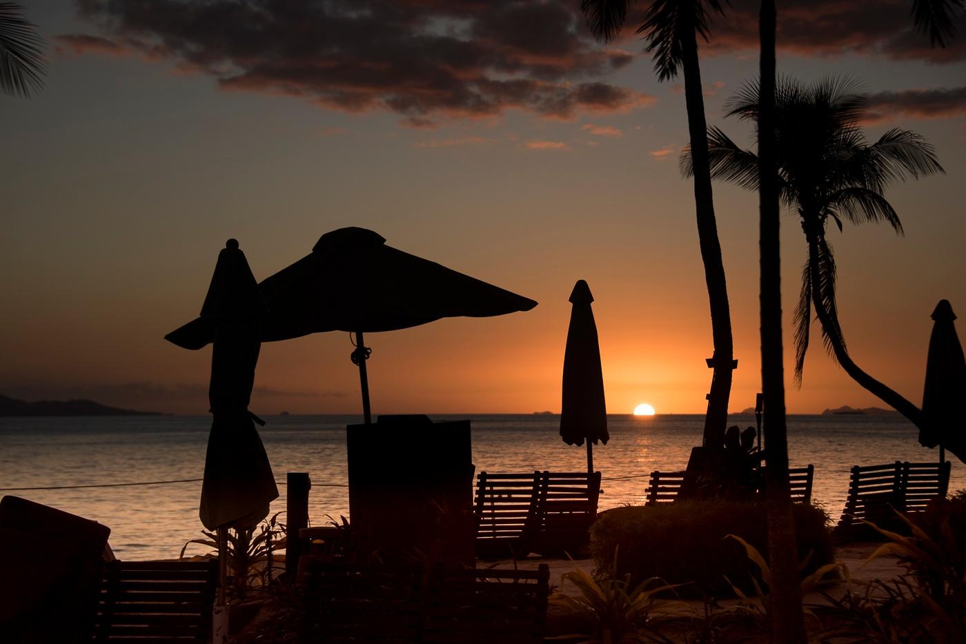 Sun setting over the Fiji Islands by Trevor McKinnon