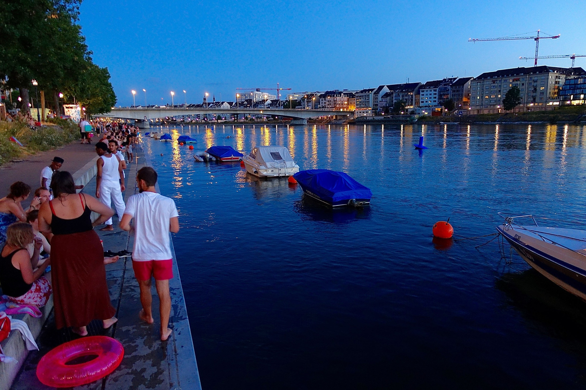 A summer evening at the Rhine in Basel Switzerland by Erwin Widmer