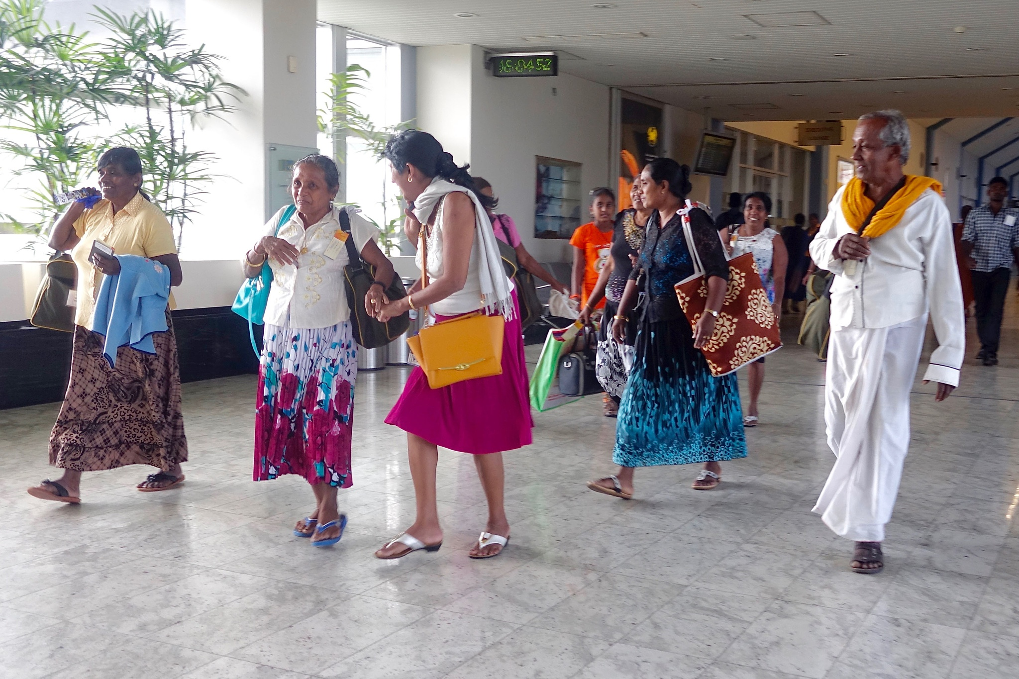 People at the airport in Colombo, Sri Lanka by Erwin Widmer