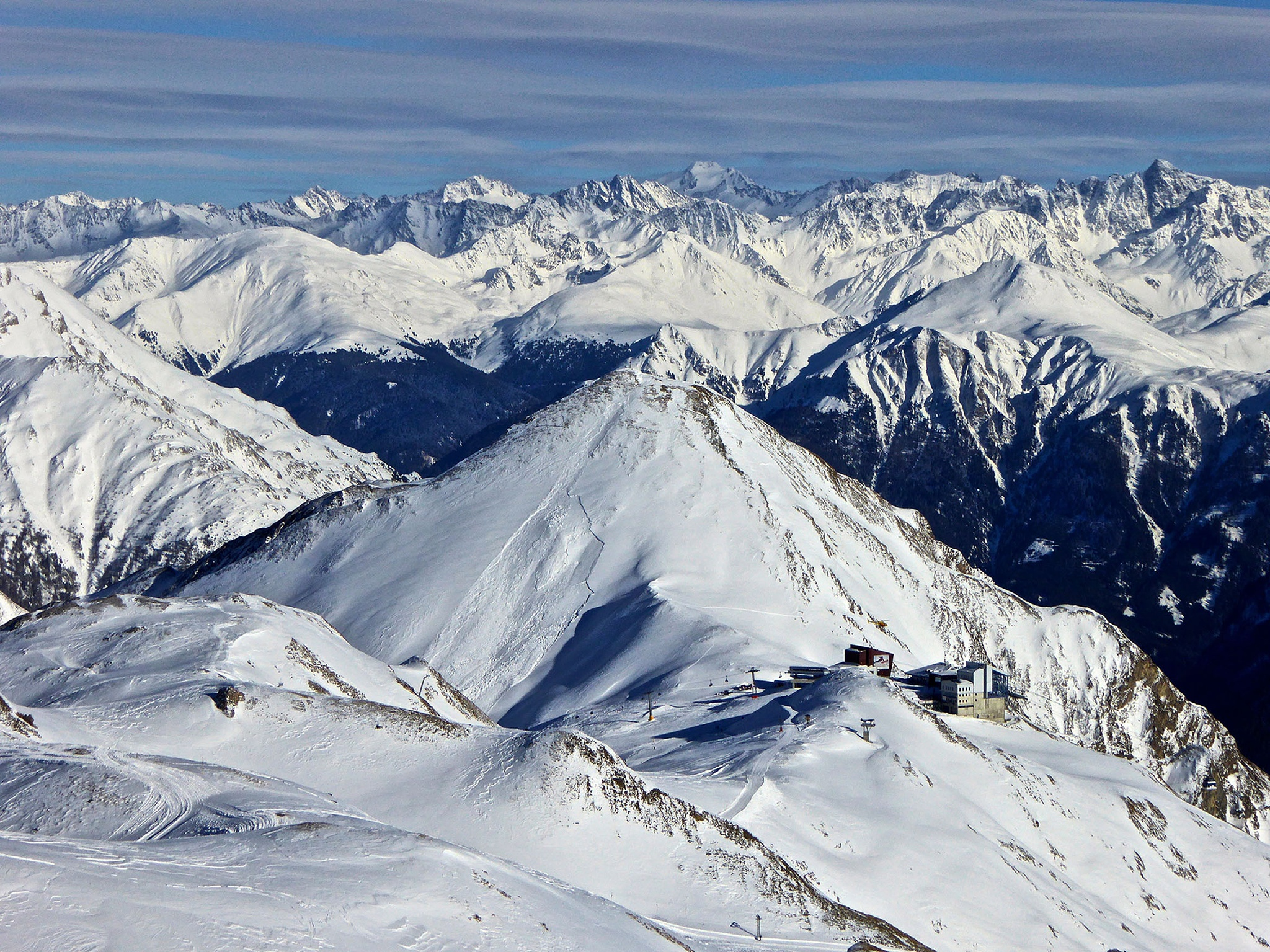 View from Greitspitz over the Skiarena of Samnaun and the Austrian mountains in the background by Erwin Widmer