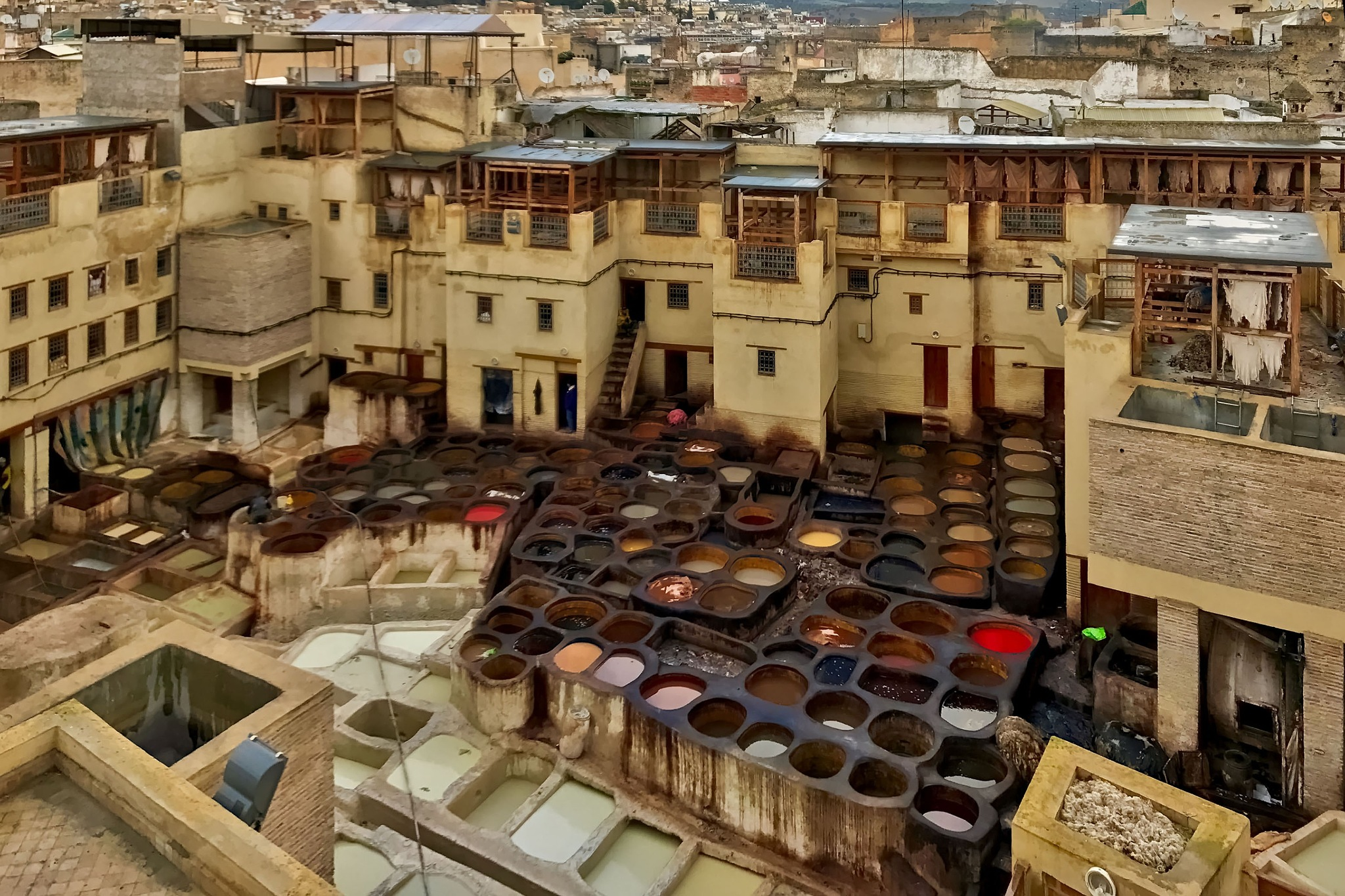 The leather tannery and dyeing operation at Fès in Morocco. by Erwin Widmer