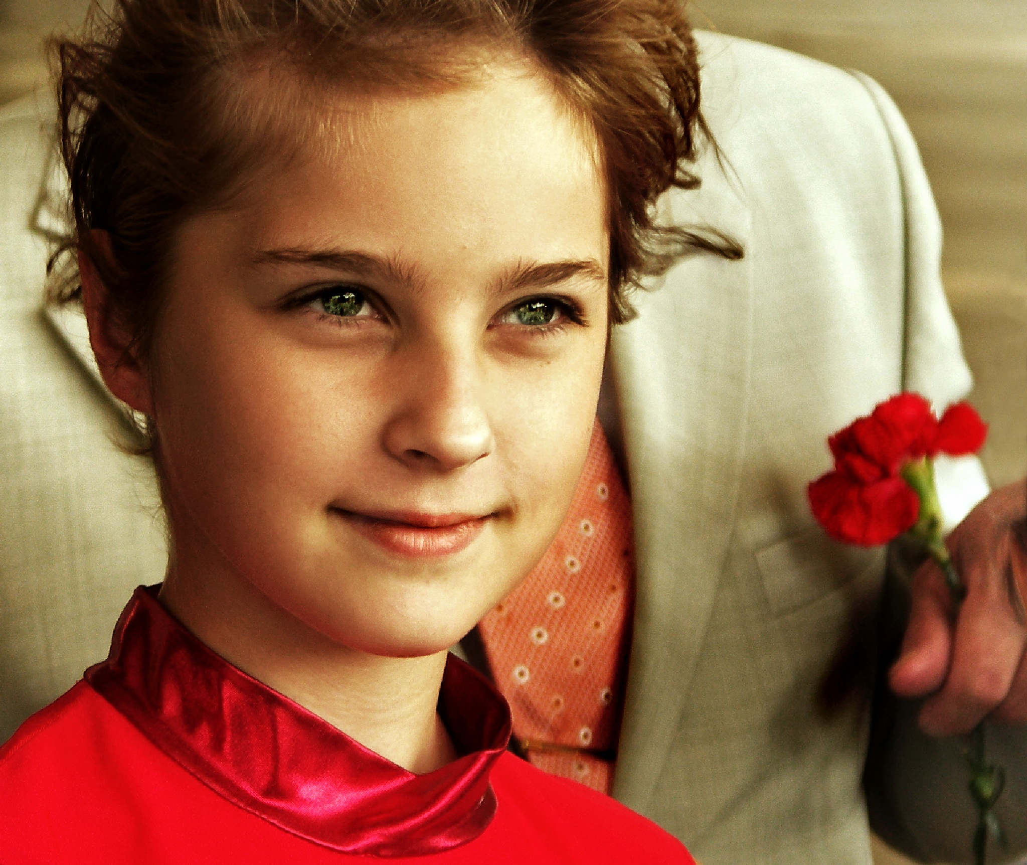 Portrait of a girl in the background of jacket mayor, who is holding a bouquet of red carnations by Сергей Юрьев