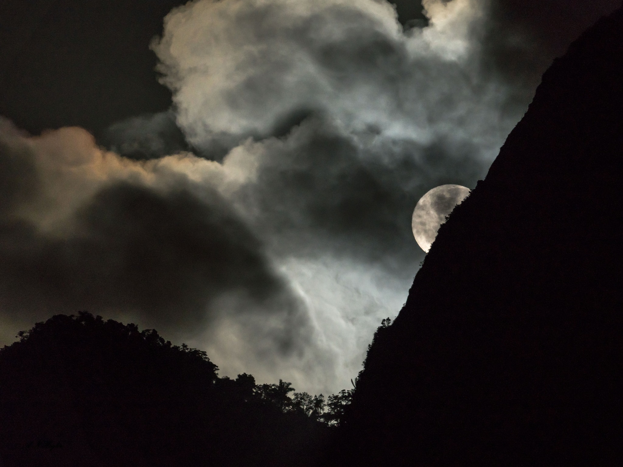 Cloudy tropical mountain moon-set by allenhagler59663852