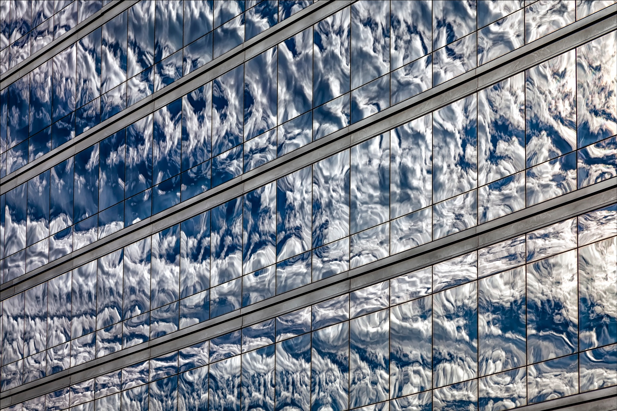 Reflective Glass Architecture Sky and Clouds by robertullmann