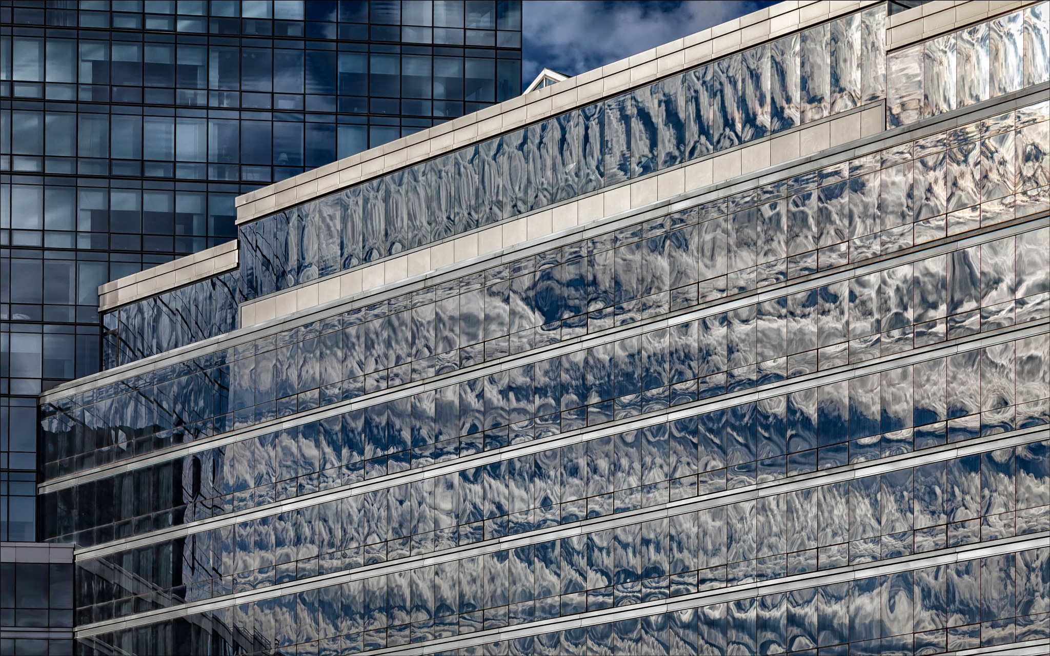 Office Buildings and  Reflected Clouds by robertullmann