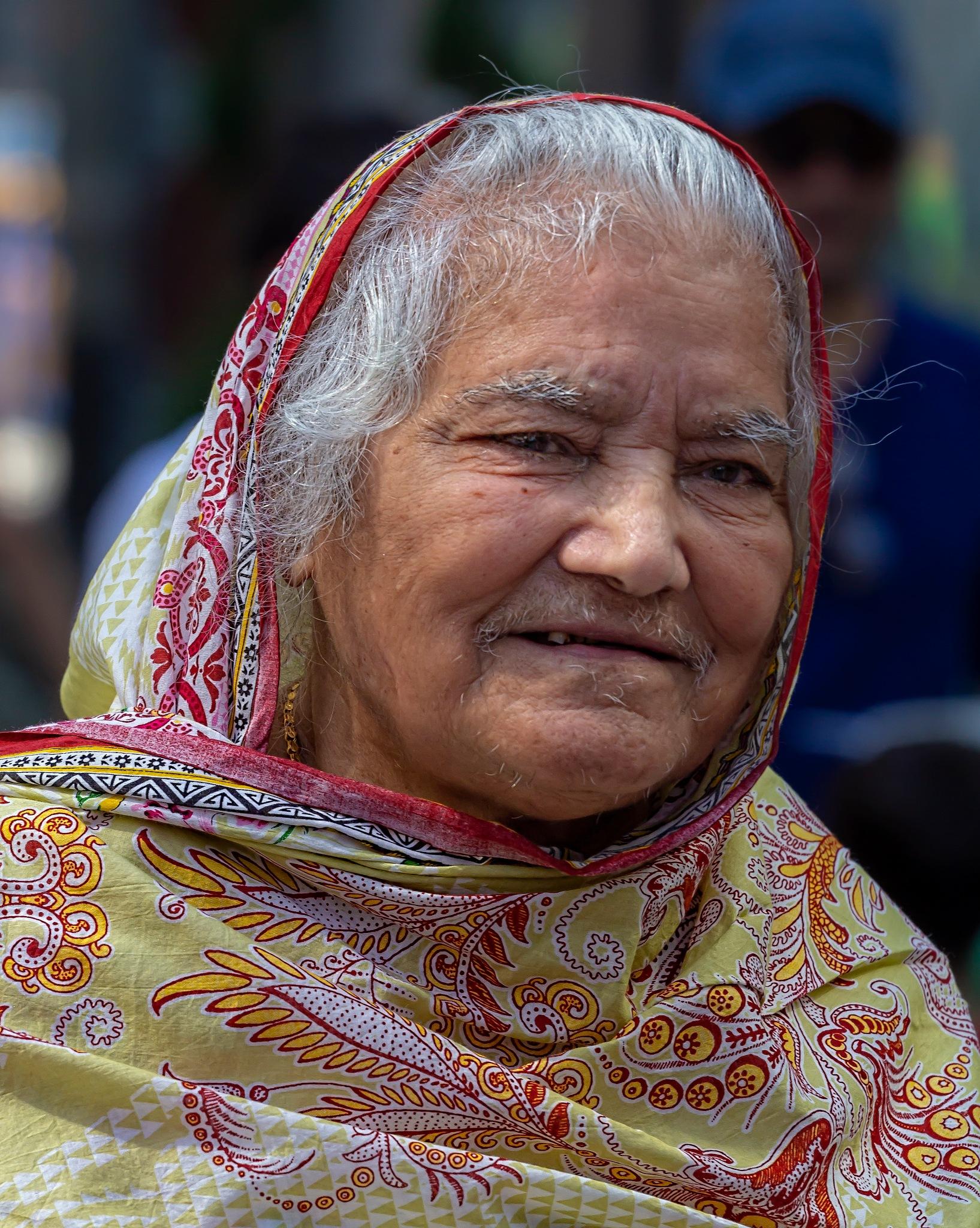 Pakistani Day NYC - Elderly Woman - Traditional Dress by robertullmann