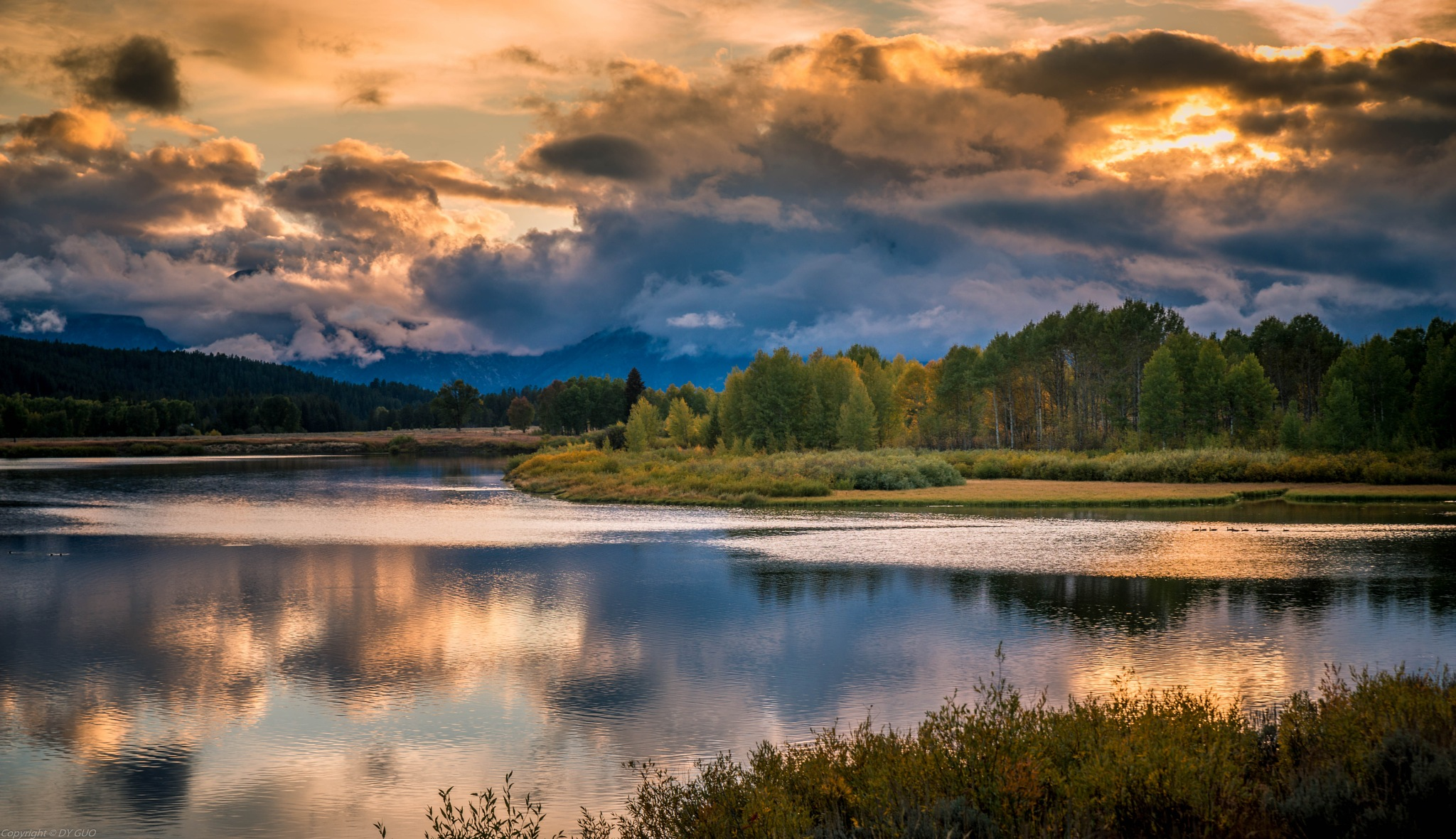 Oxbow Bend at sunset by David Guo