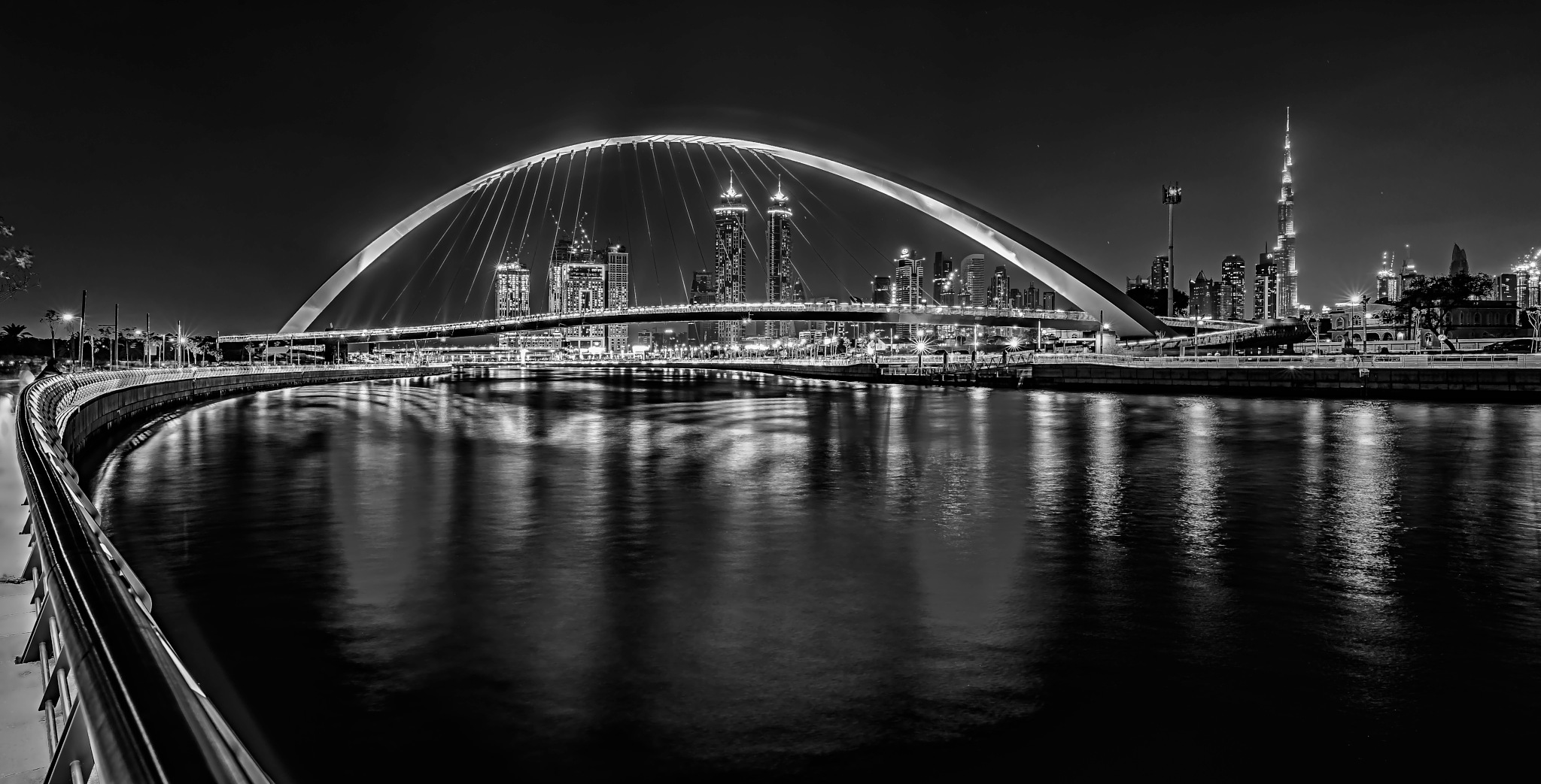 Photo in Black and White #uae #dubai #black & white #monochrome #water #sea #dubai creek #dubai water canal #arch #bridge #burj khalifa #building #built structure #skyline #skyscraper #city #cityscape #united arab emirates #night photography #long exposure #nightscape #alvin ablaneda #d800