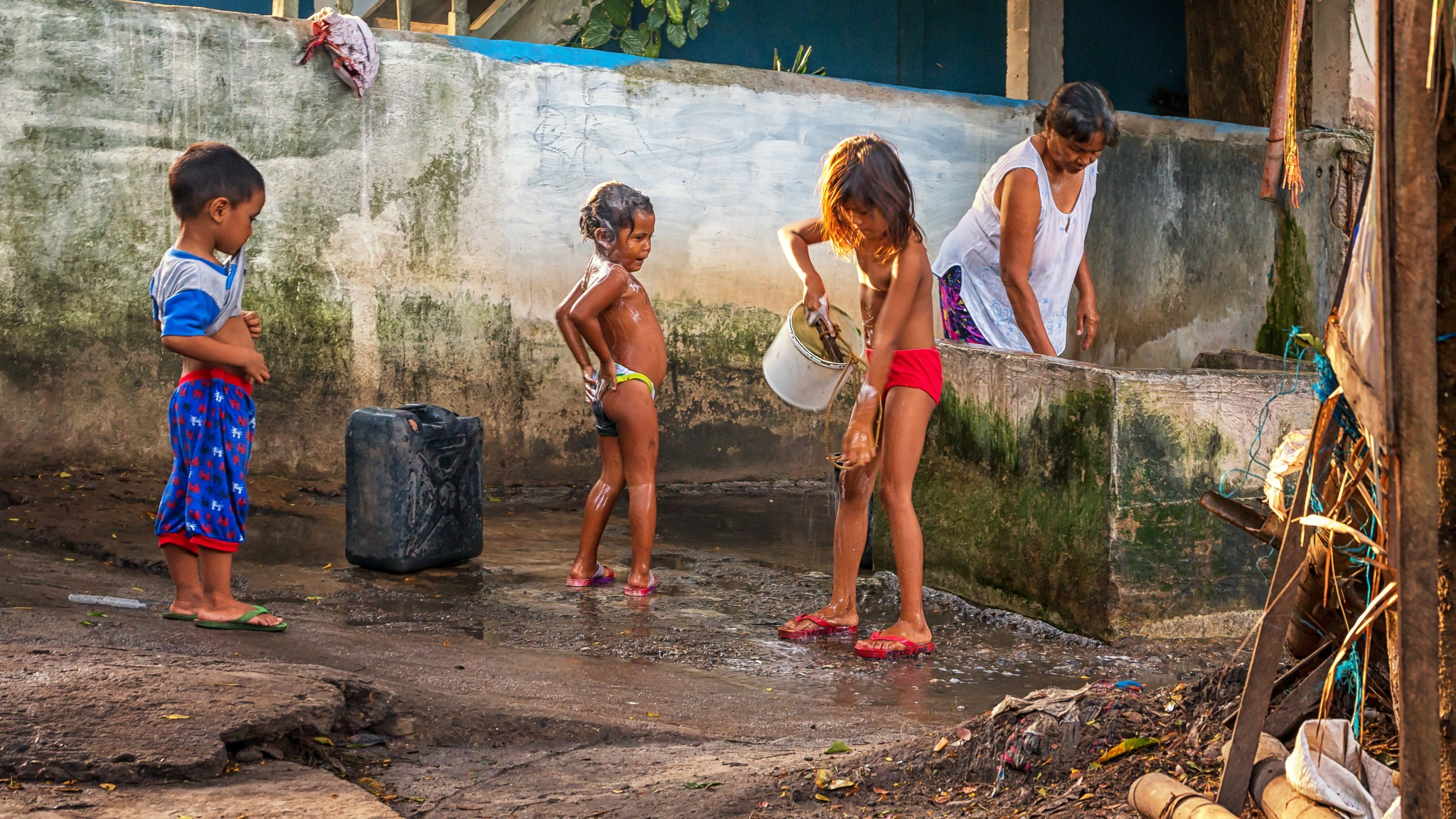 Photo in Travel #washing #children #kids #family #mother #soap #street #streetphotography #travel #village #poem #poetry #precious water #precious #apo island #apo #philippines #photopoetry #island #every day life