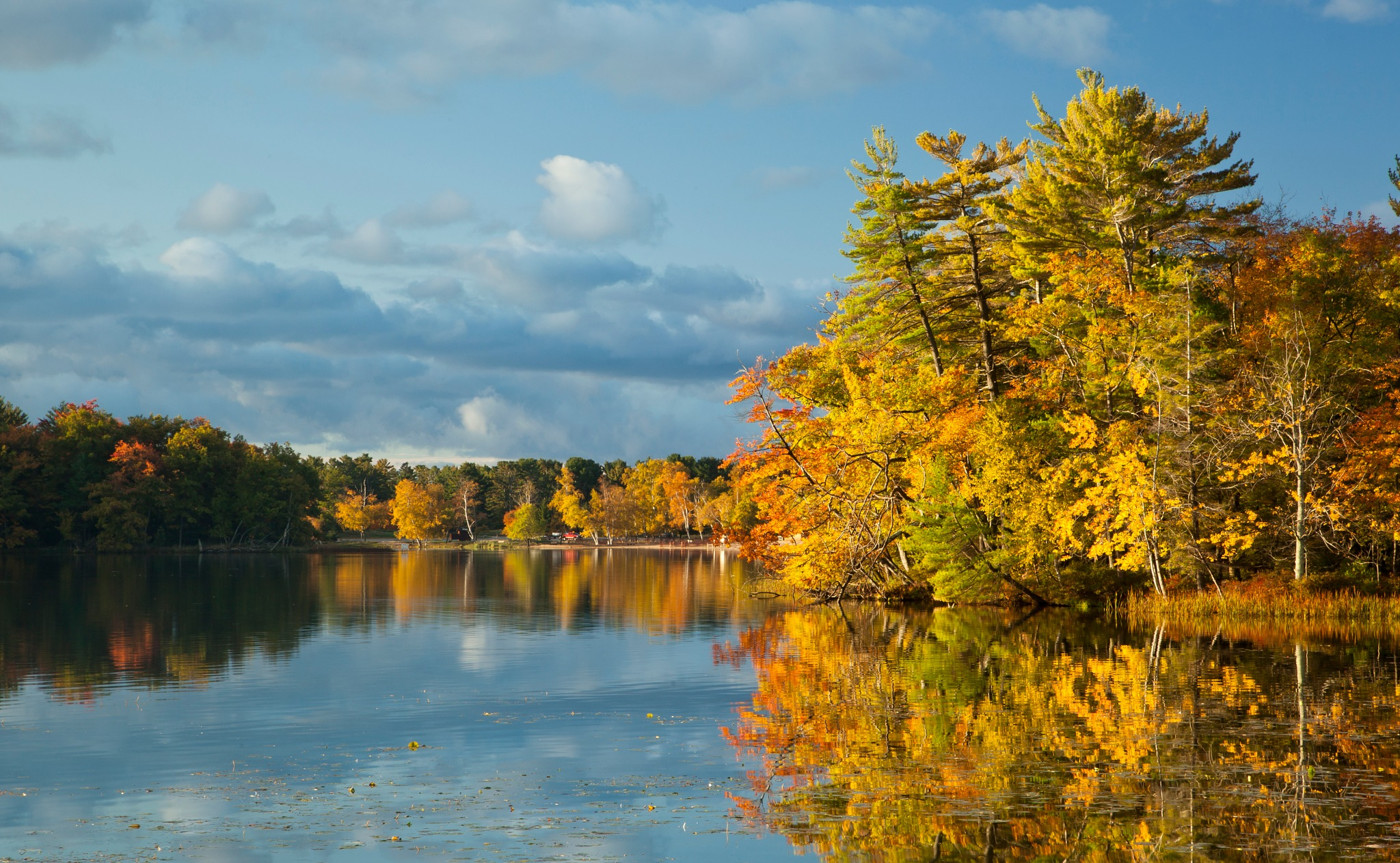 Autumn Colors Over Hamlin Lake by Kevin Kludy
