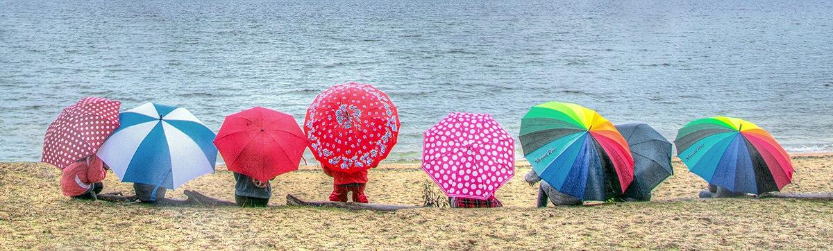 Umbrellas on the beach by MadeleineGuenette