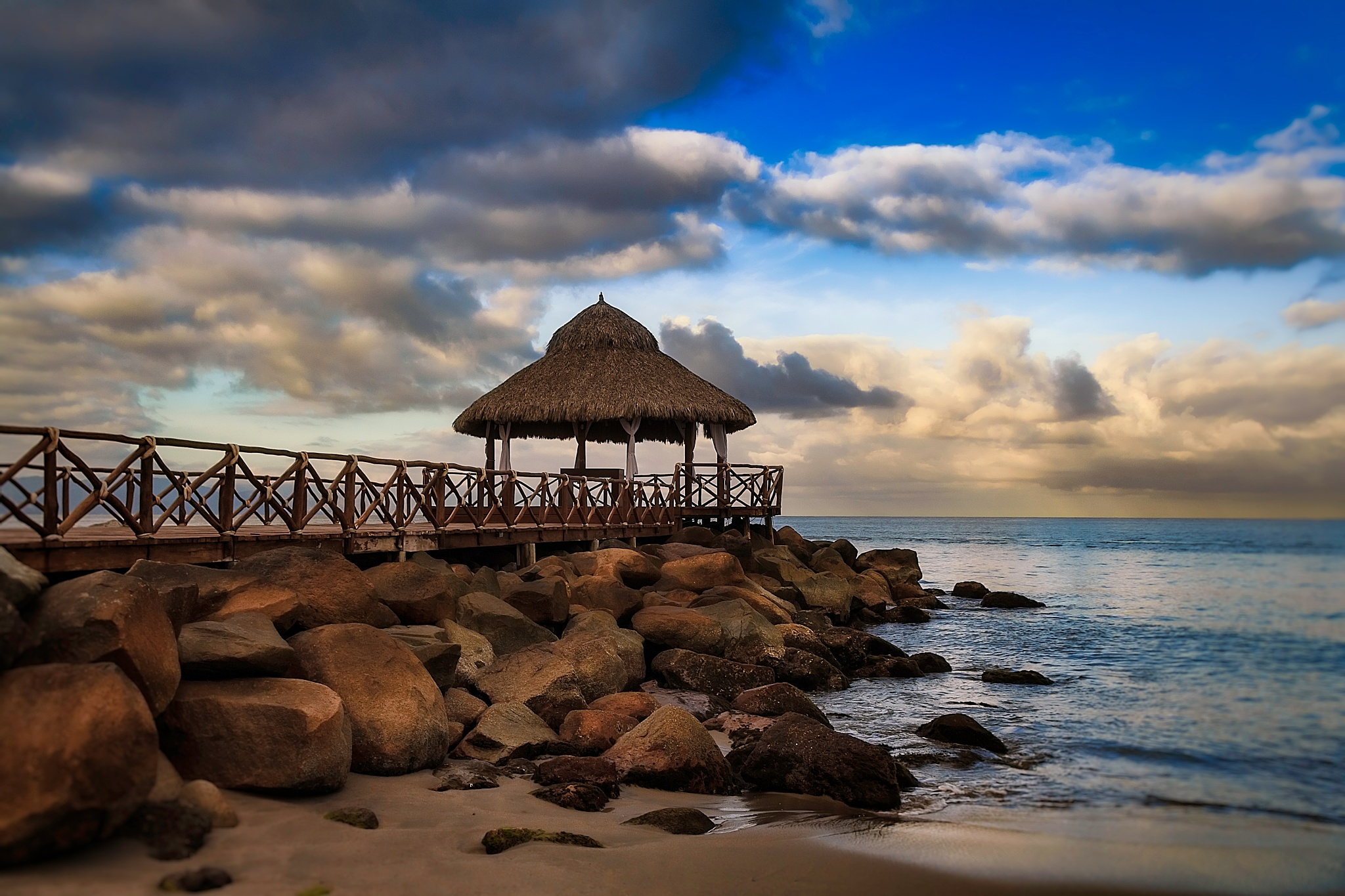 Photo in Travel #ocean #palapa #mexico #pacific ocean #water #clouds #rocks #sand #beach