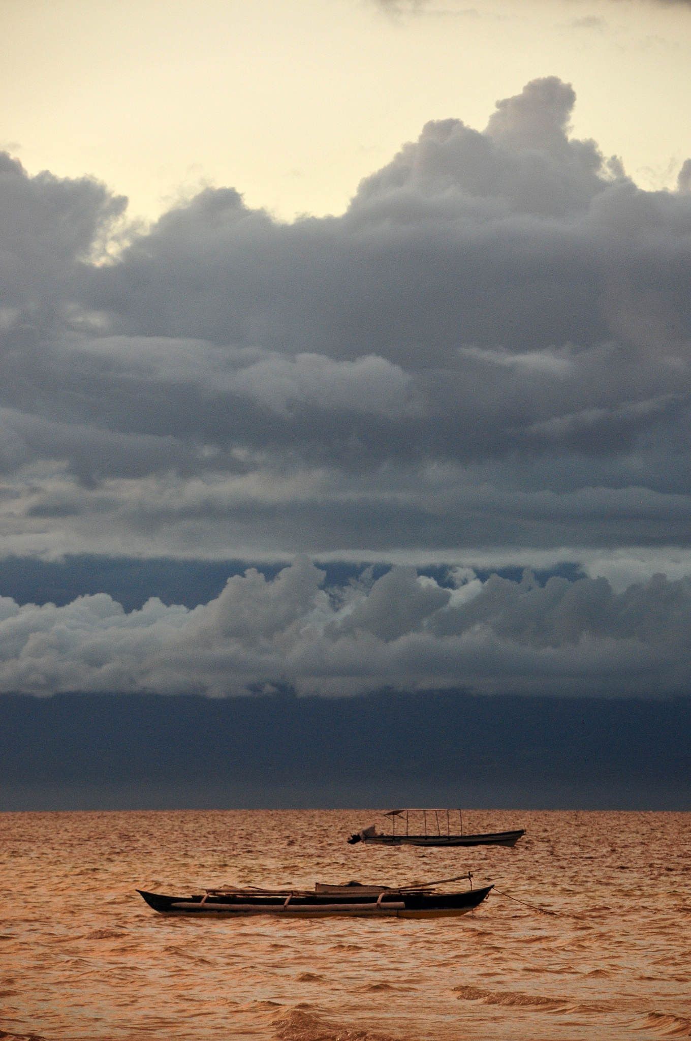 Dark clouds on a copper-like sea by JeanGregoireMarin