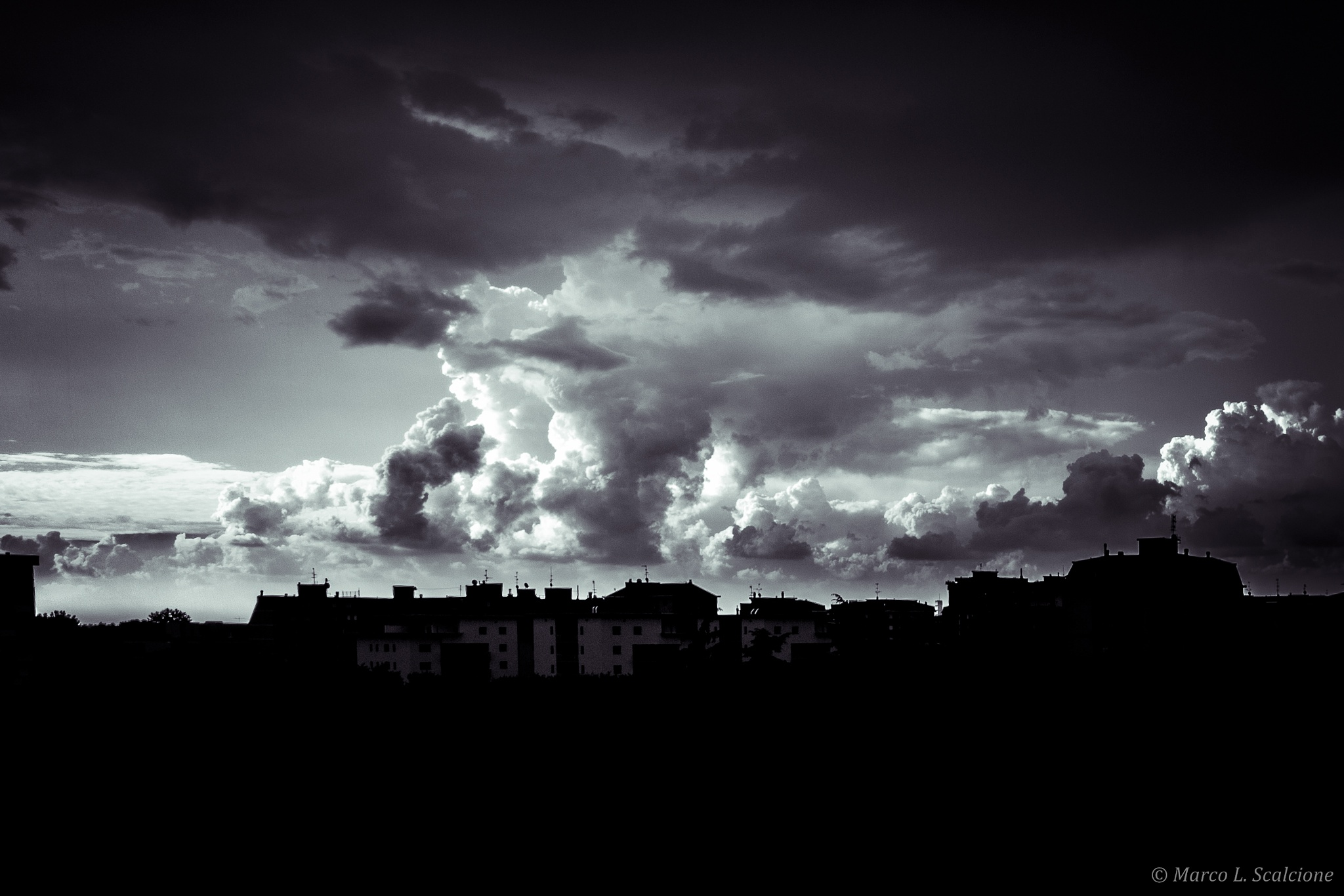 Black clouds by Marco Scalcione