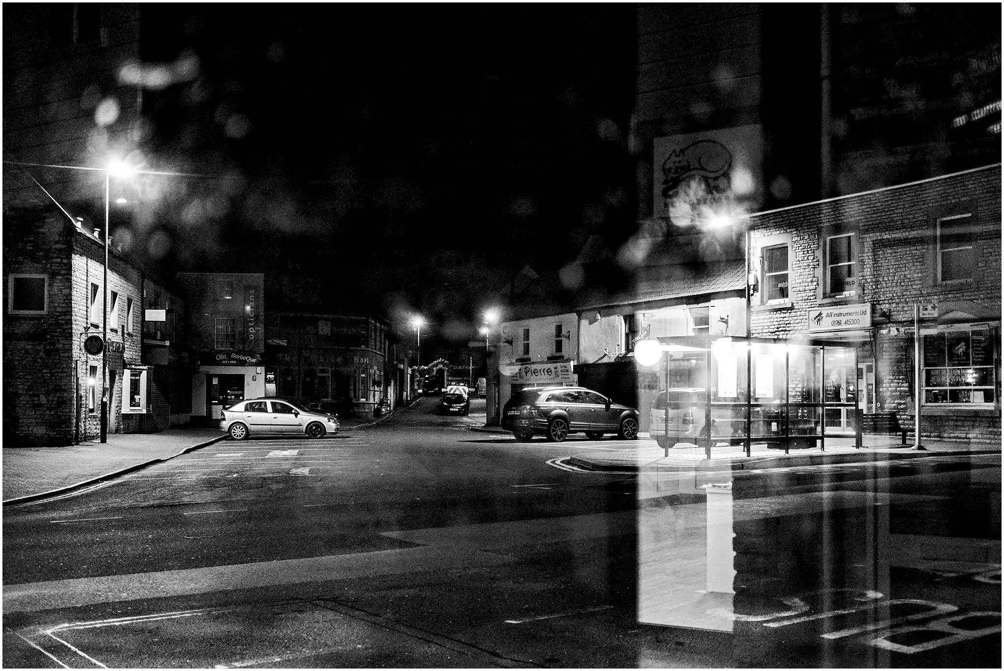 Bus Stop View - B&W by Clive Ayron