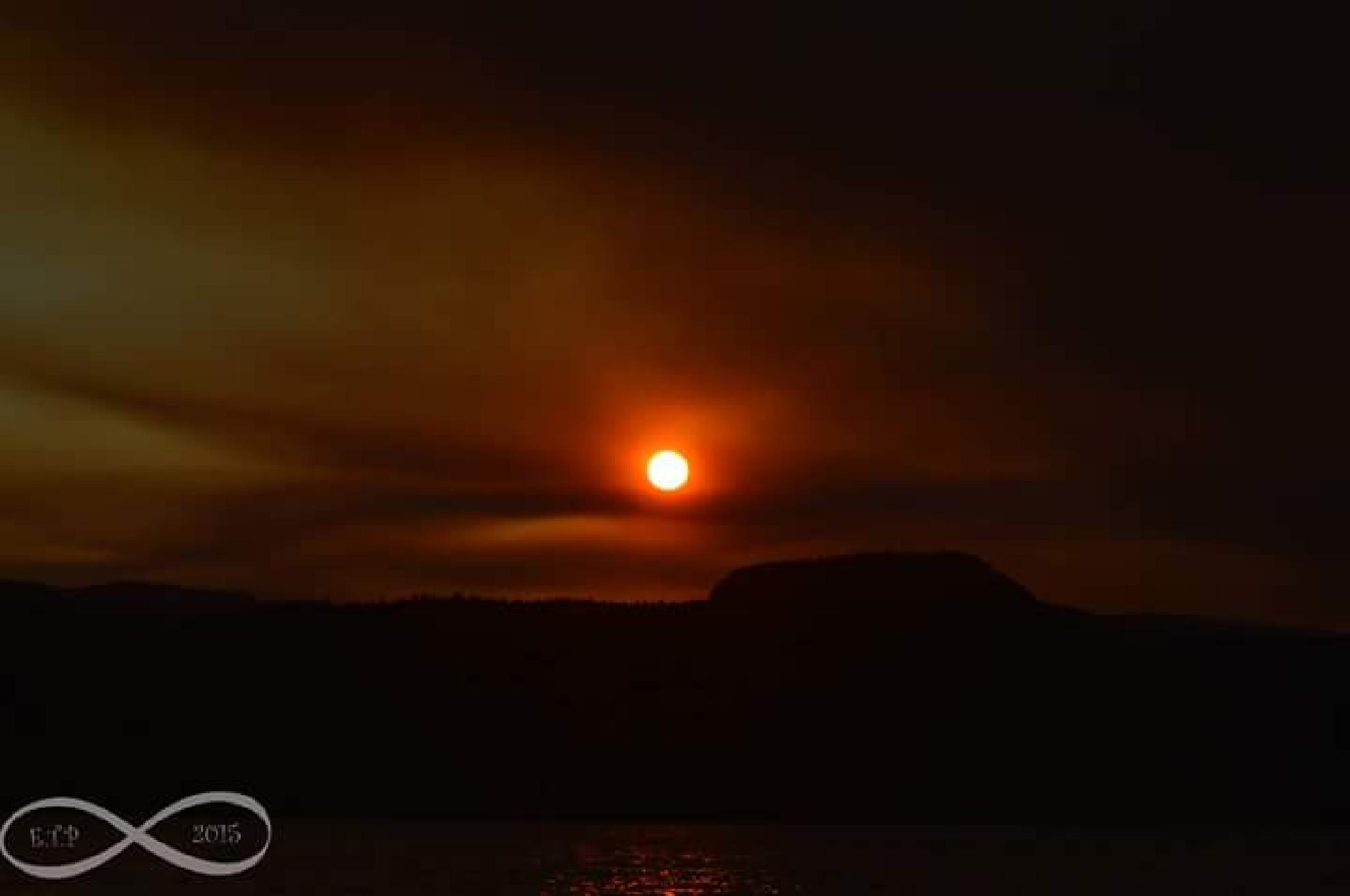 Sunset throught the smoke of 3 fires by Erin Tilley Photography