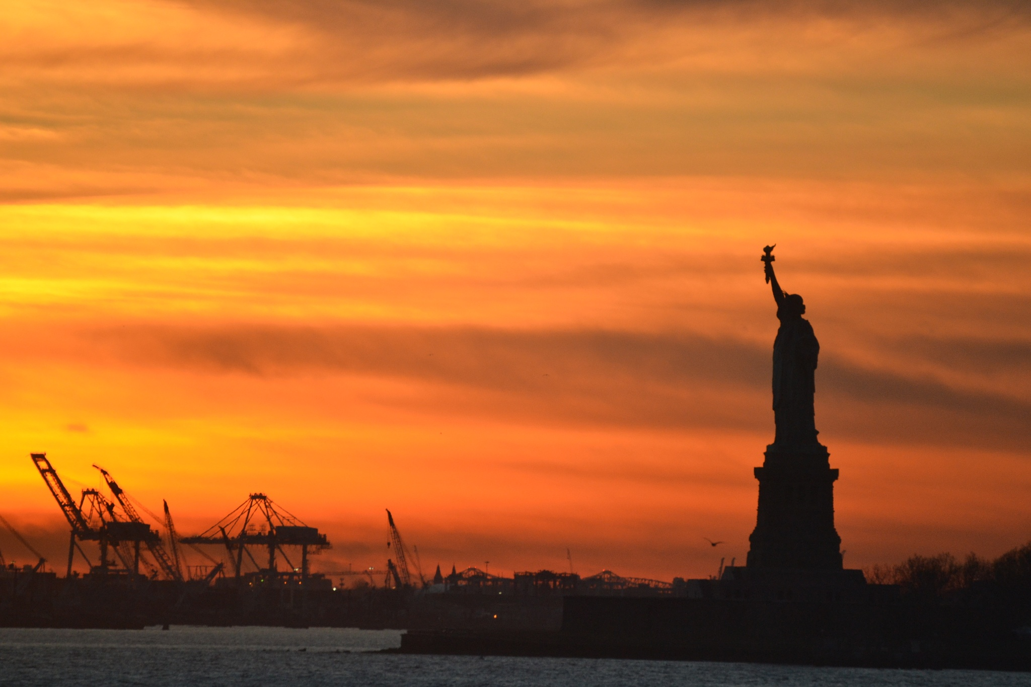 Statue of Liberty at sunset by Kathleen Hutchison